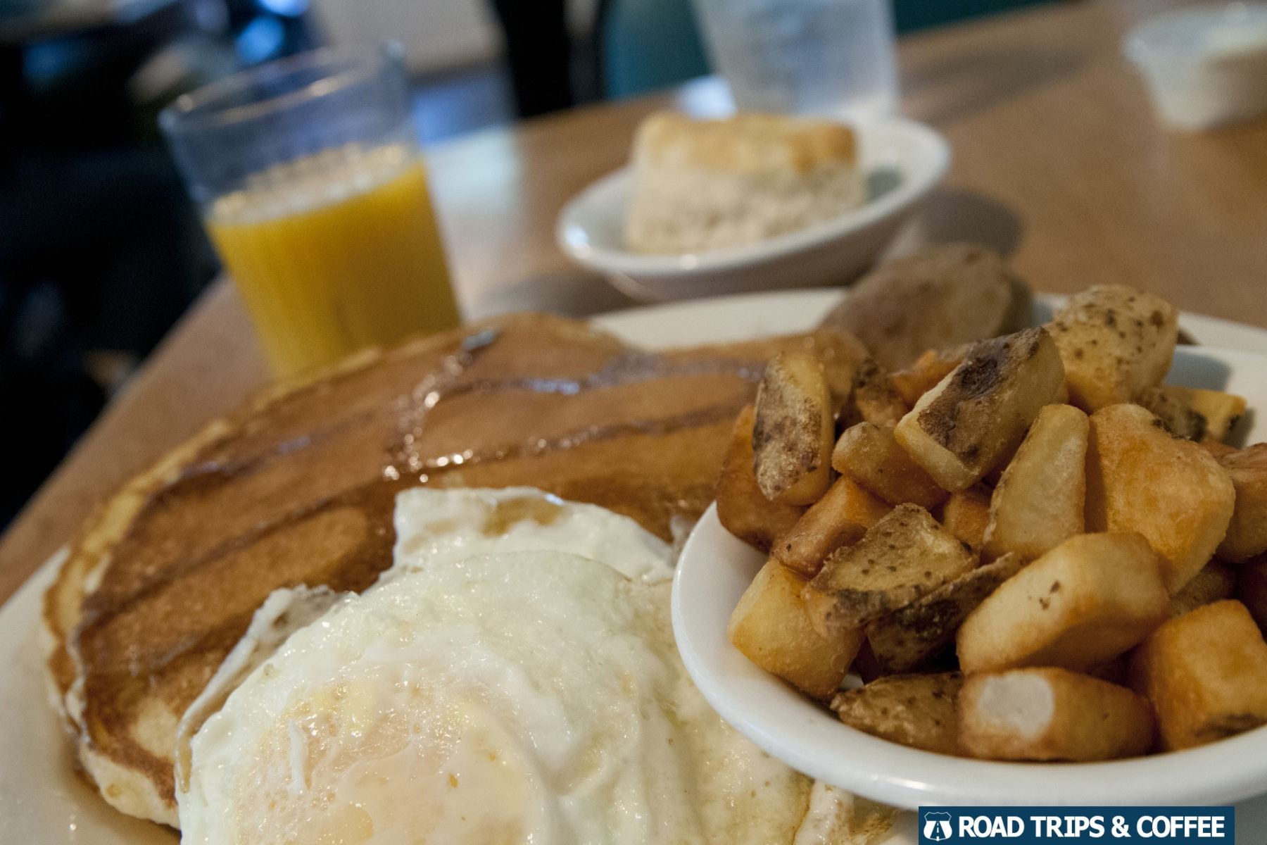 Large breakfast plate loaded with pancakes, eggs, and potatoes at the Mabry Mill Restaurant on the Blue Ridge Parkway in Virginia