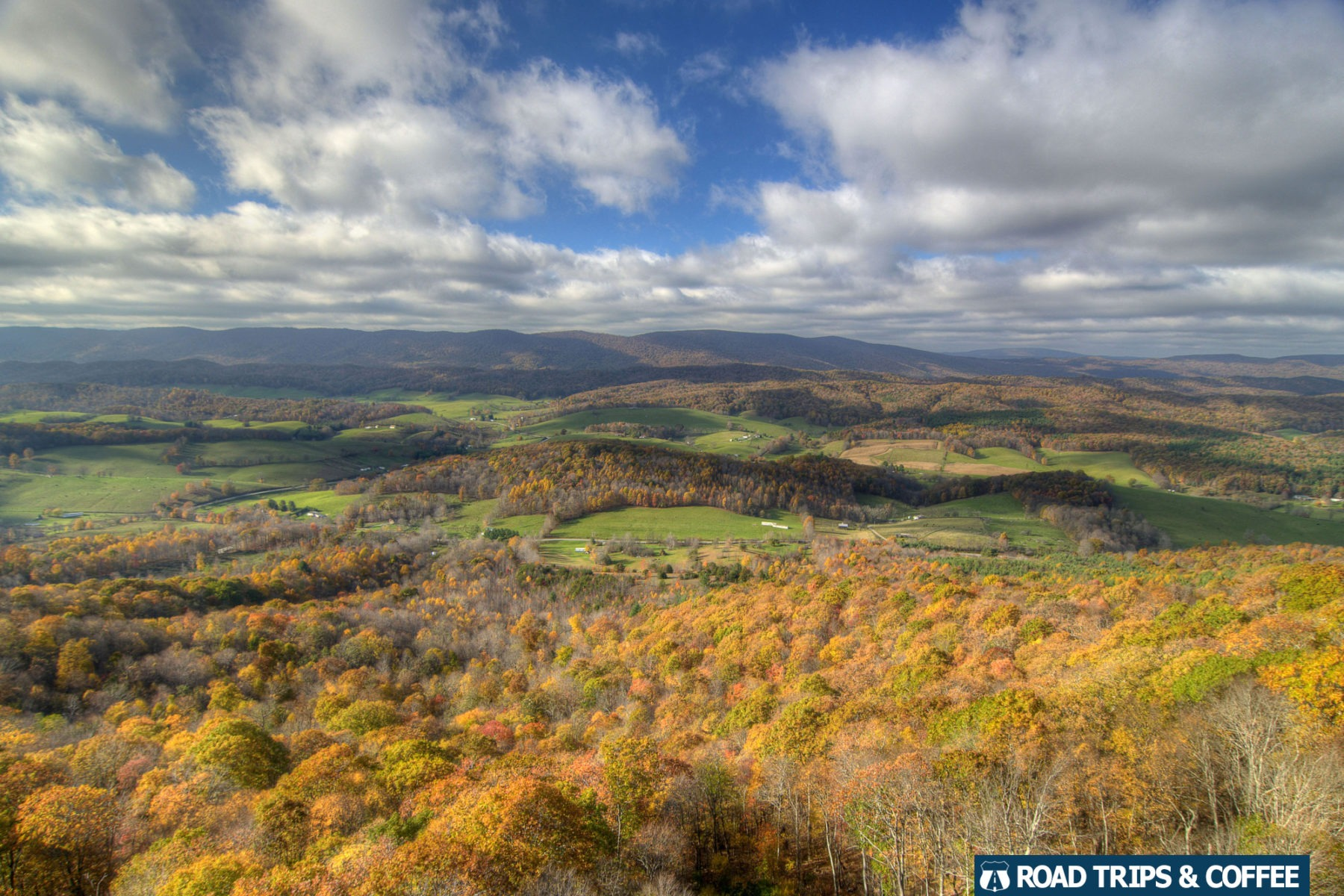 Fall colors begin to peak across the valley and mountains beneath the Big Walker Lookout in Wytheville, Virginia
