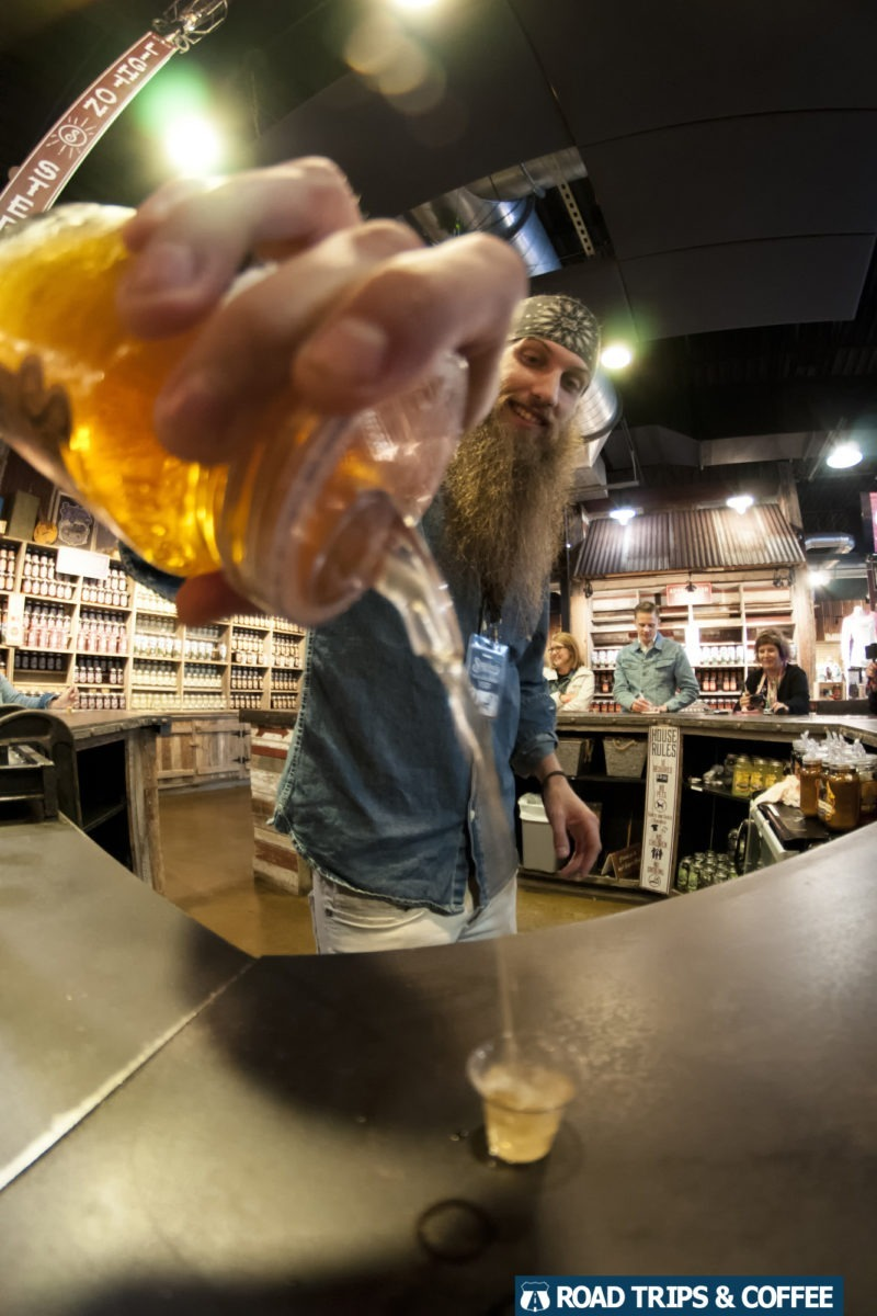 O'Dammit pours a small shot of moonshine during a tasting at Sugarlands Distilling Company in Gatlinburg, Tennessee