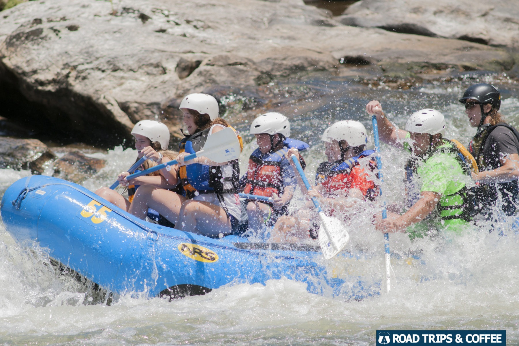 A boat full of rafters enjoy the spray from the whitewater rapids along the Chattooga River in South Carolina.