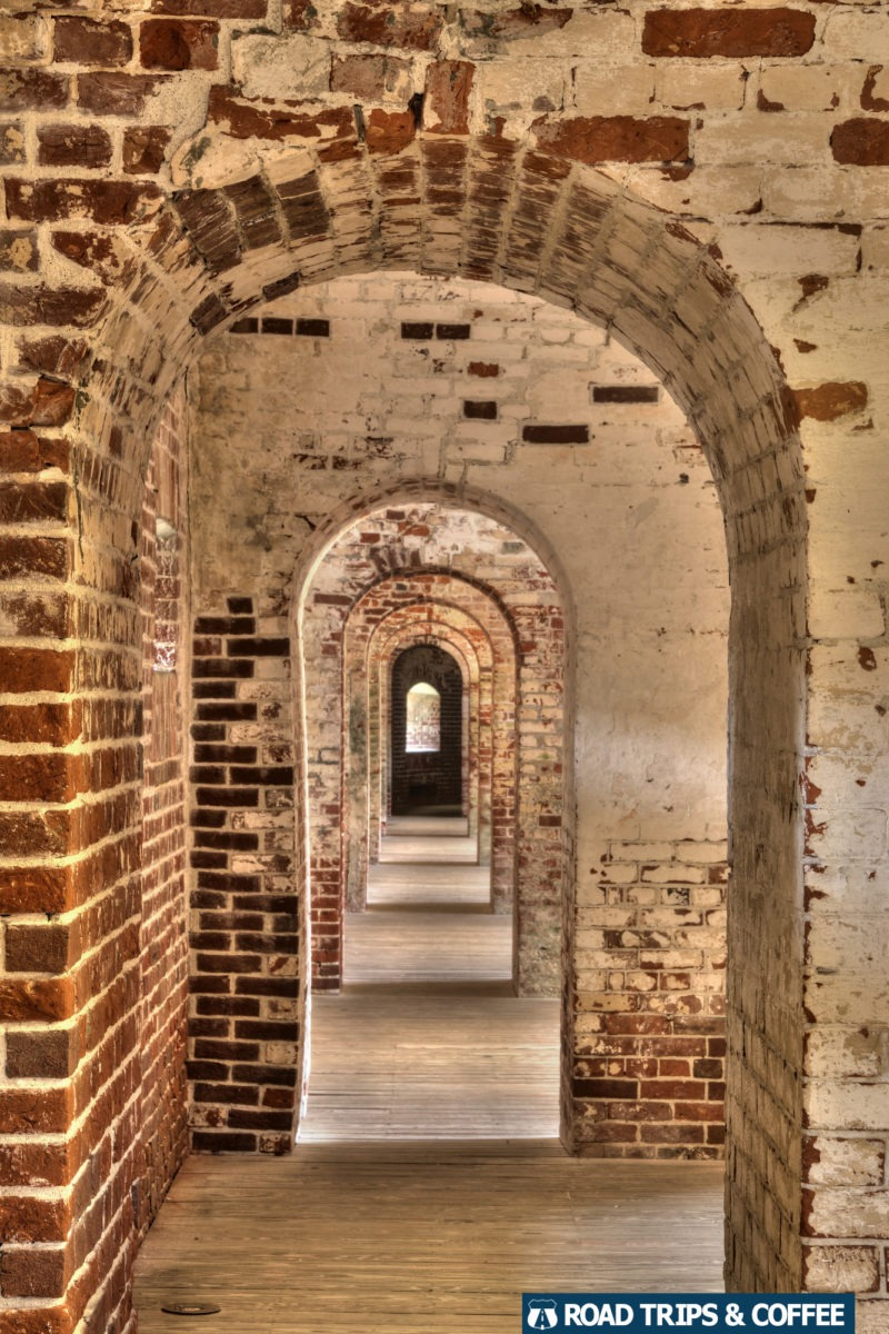 Arched brick doorways, one after another, connecting the rear section of rooms inside Fort Macon State Park in Atlantic Beach, North Carolina