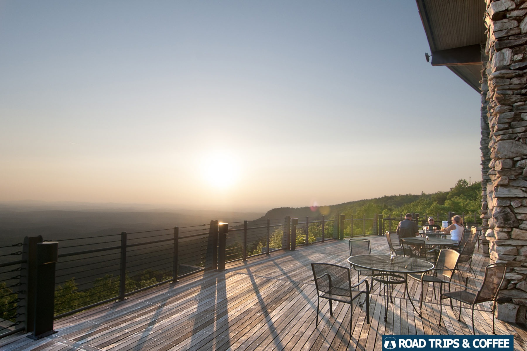 Sunset across a wide wooden deck at Cheaha State Park in Alabama.