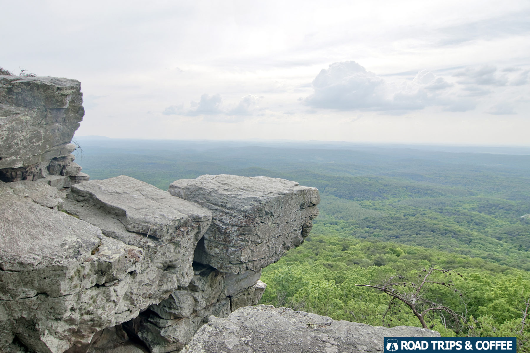 View at the edge of a cliff overlooking a vast landscape from Pulpit Rock at Cheaha State Park in Alabama.