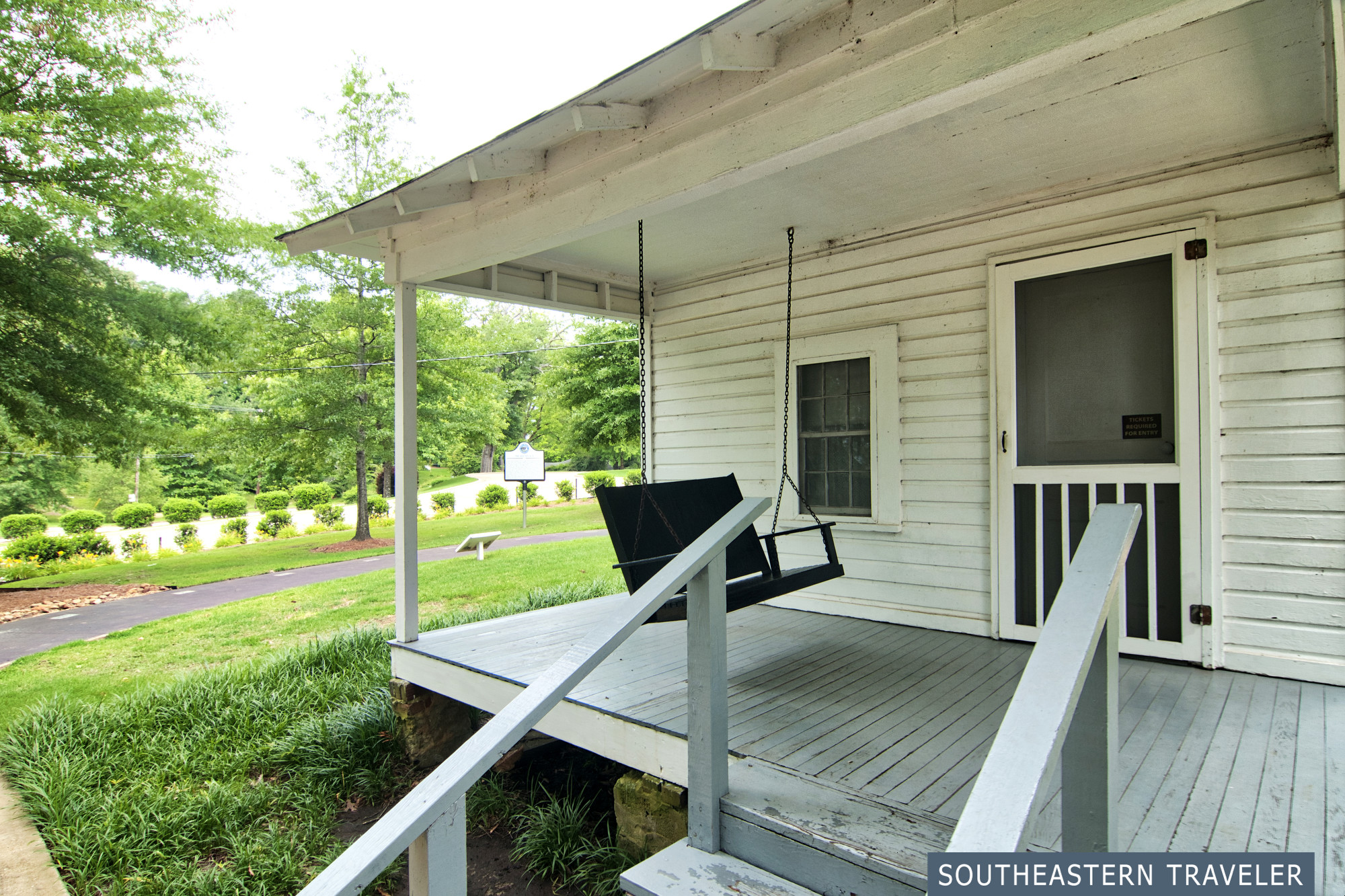 Porch swing on a white house where Elvis Presley was born in Tupelo, Mississippi