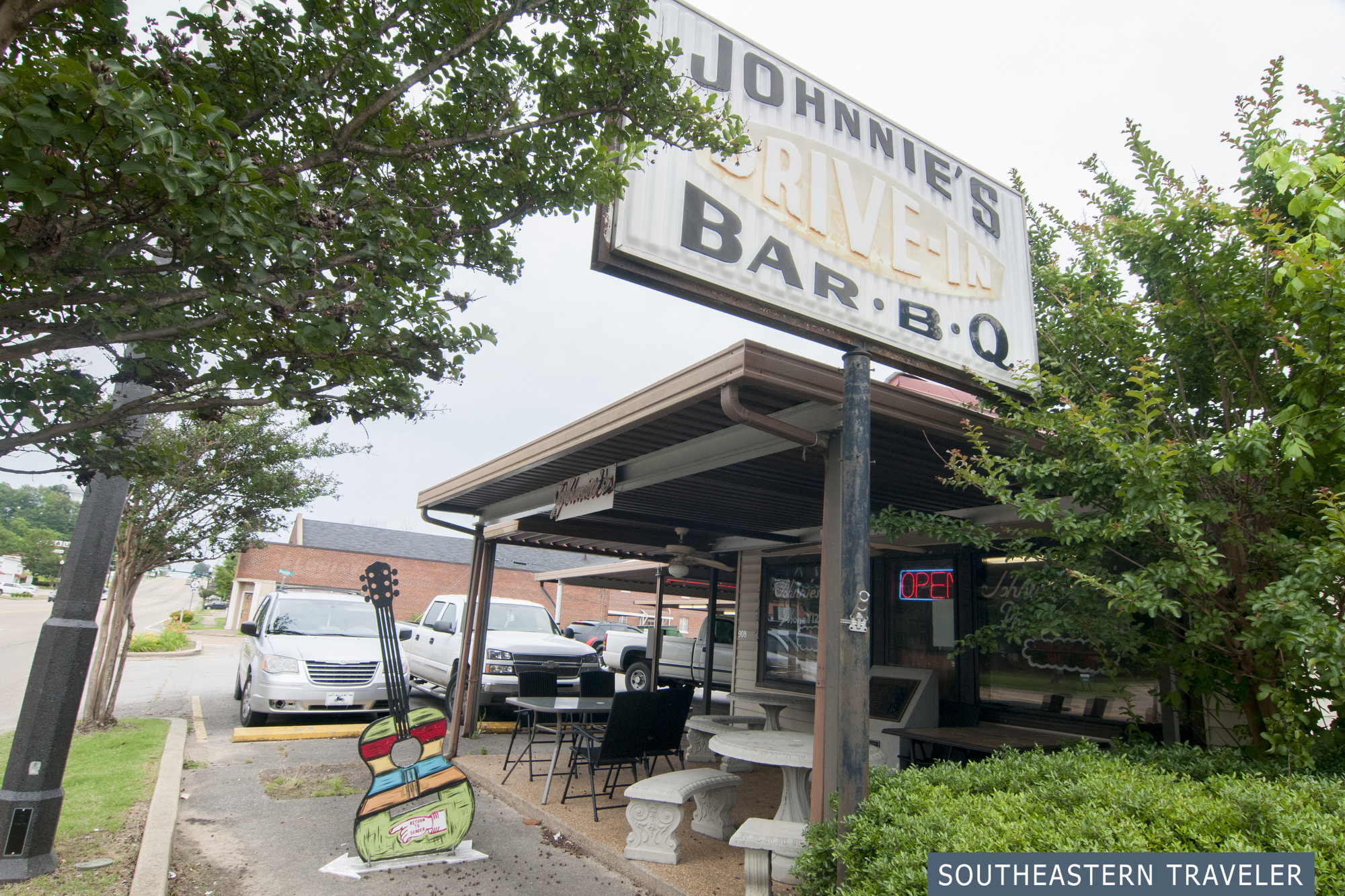 Large sign reading Johnnie's Drive-In Bar-B-Q, a place where Elvis Presley would get food in Tupelo, Mississippi