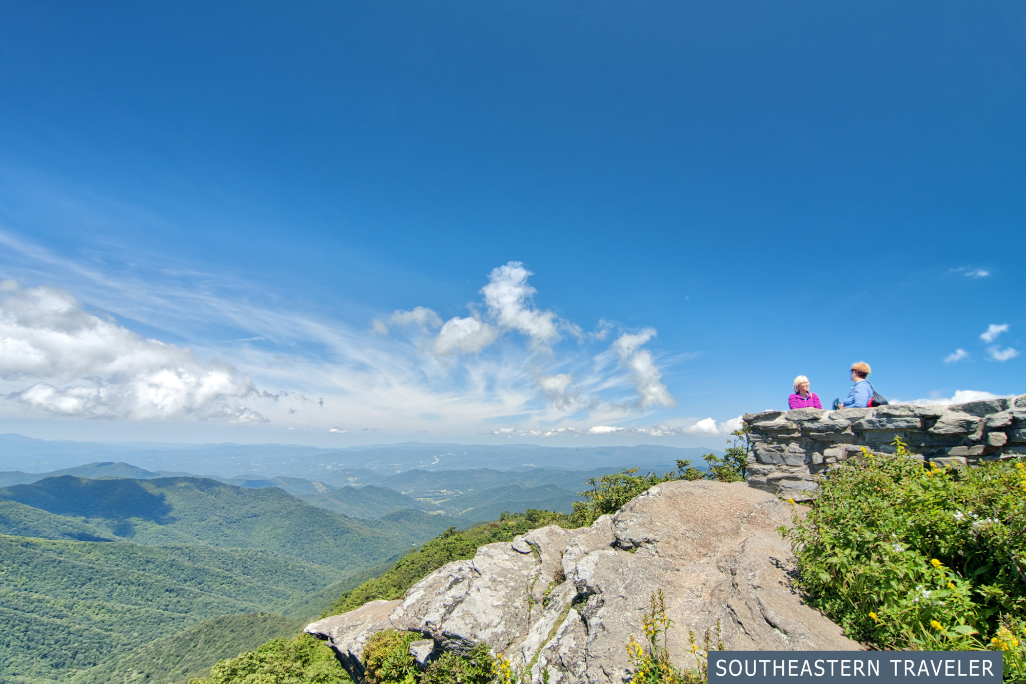People enjoy the view from Craggy Pinnacle on the Blue Ridge Parkway near Asheville, North Carolina