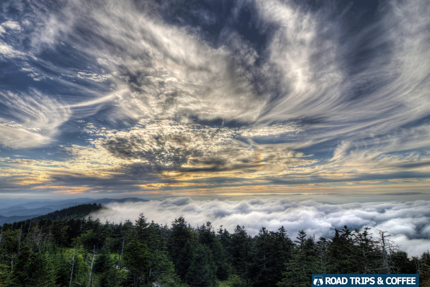 A heavy fog lingers on the mountains beneath Clingman's Dome at the Great Smoky Mountains National Park in Tennessee