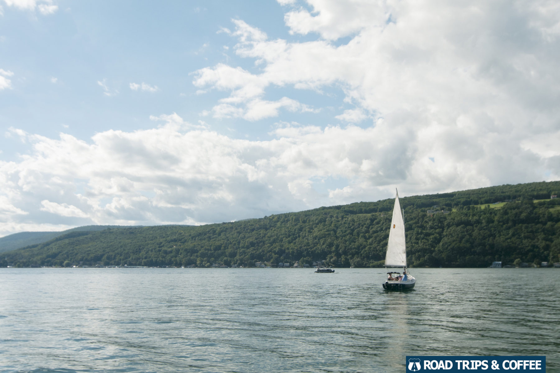 A single sailboat on the large Keuka Lake in Hammondsport, New York
