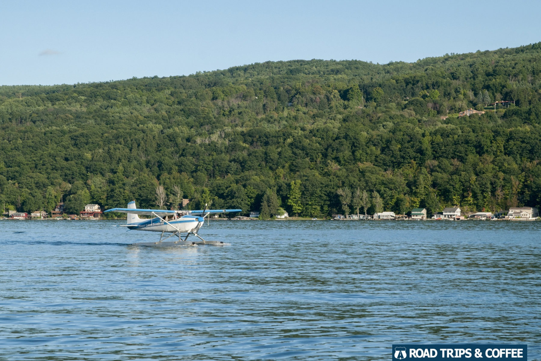 A seaplane comes in for a landing on Keuka Lake in Hammondsport, New York