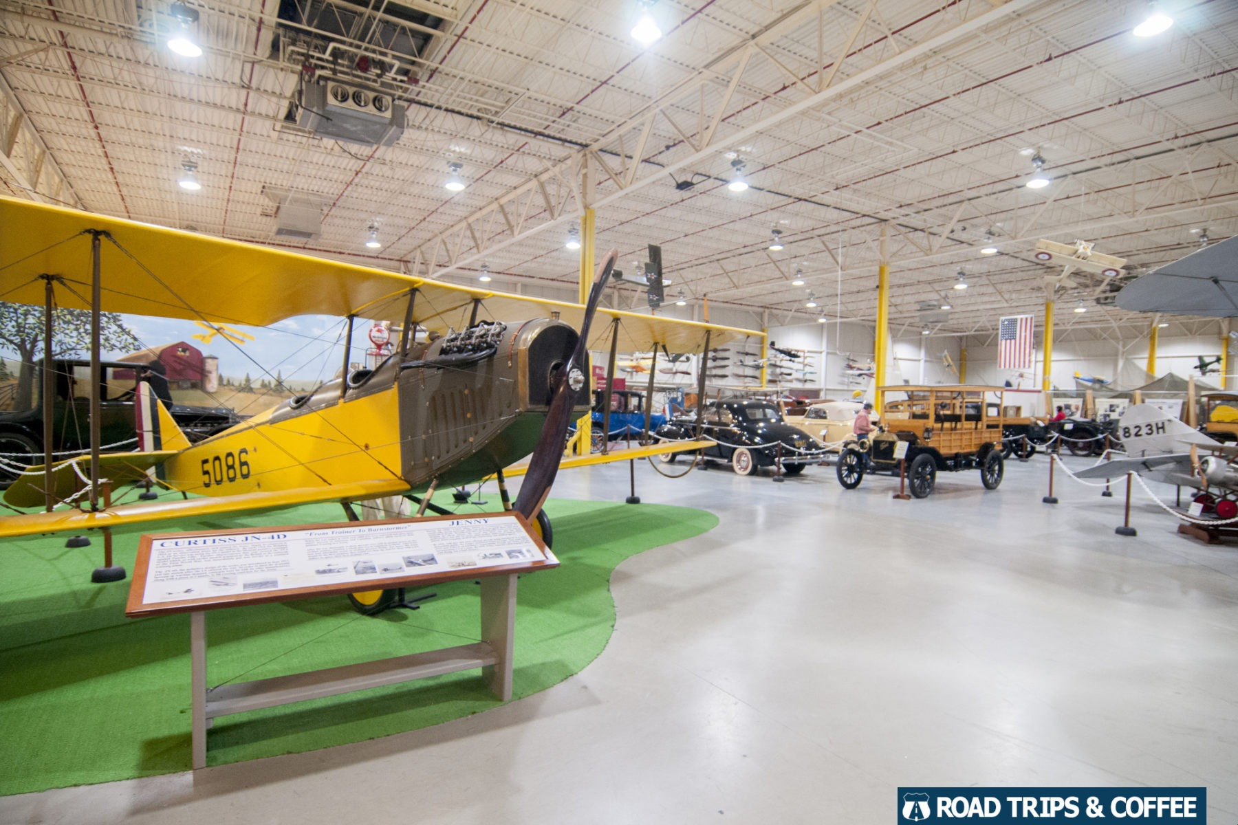 Several large planes and cars and display inside the cavernous Glenn H. Curtiss Museum in Hammondsport, New York
