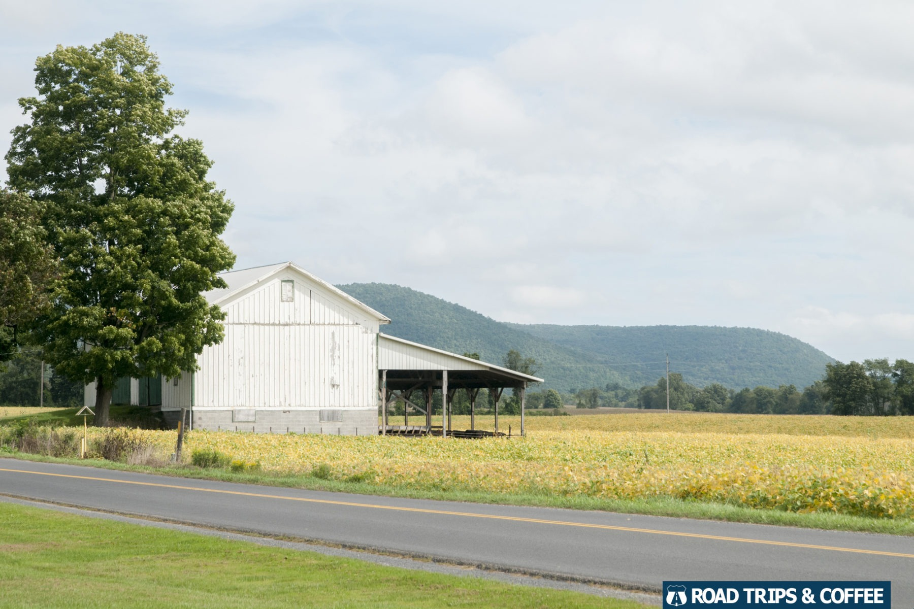 An old white barn with a great view in Hammondsport, New York