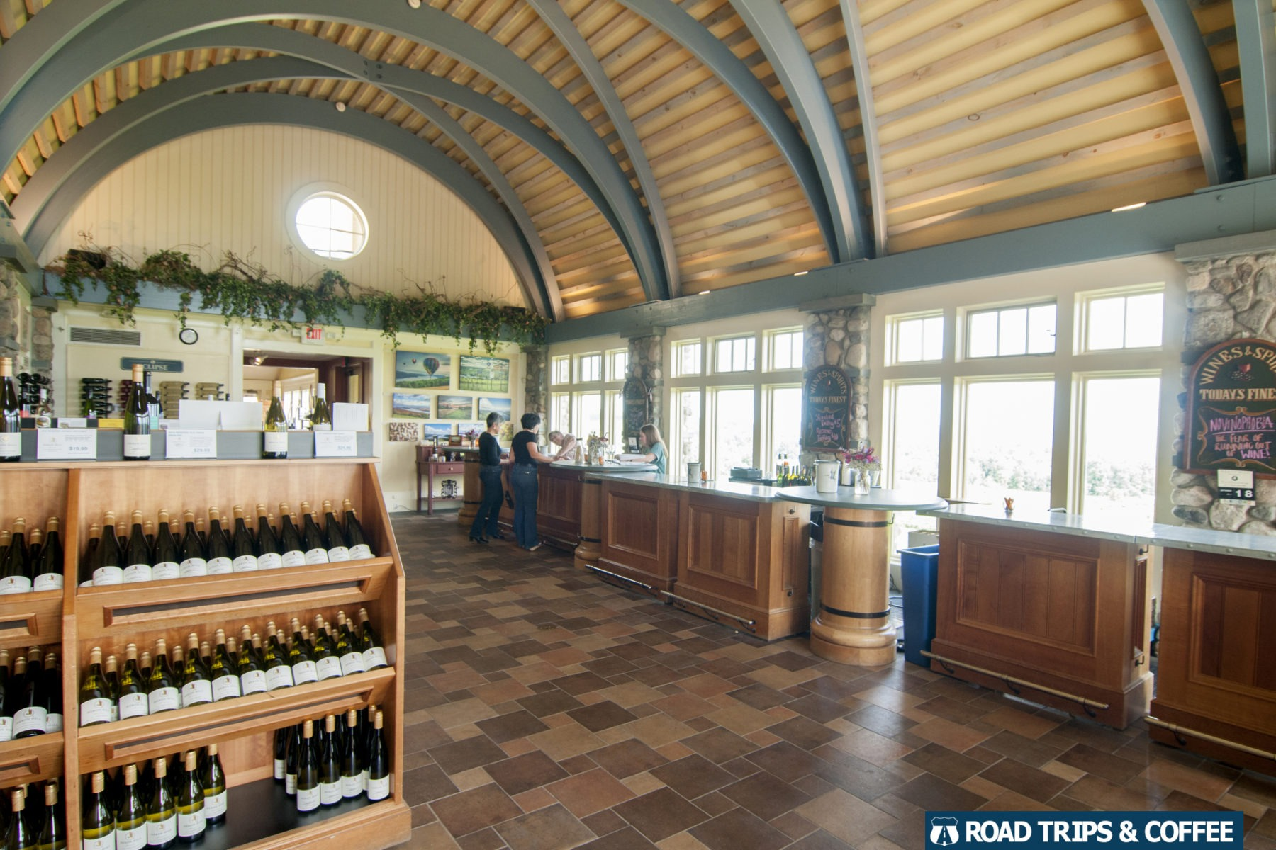 A cavernous tasting room filled with racks of wine and a tasting bar at Heron Hill Winery in Hammondsport, New York