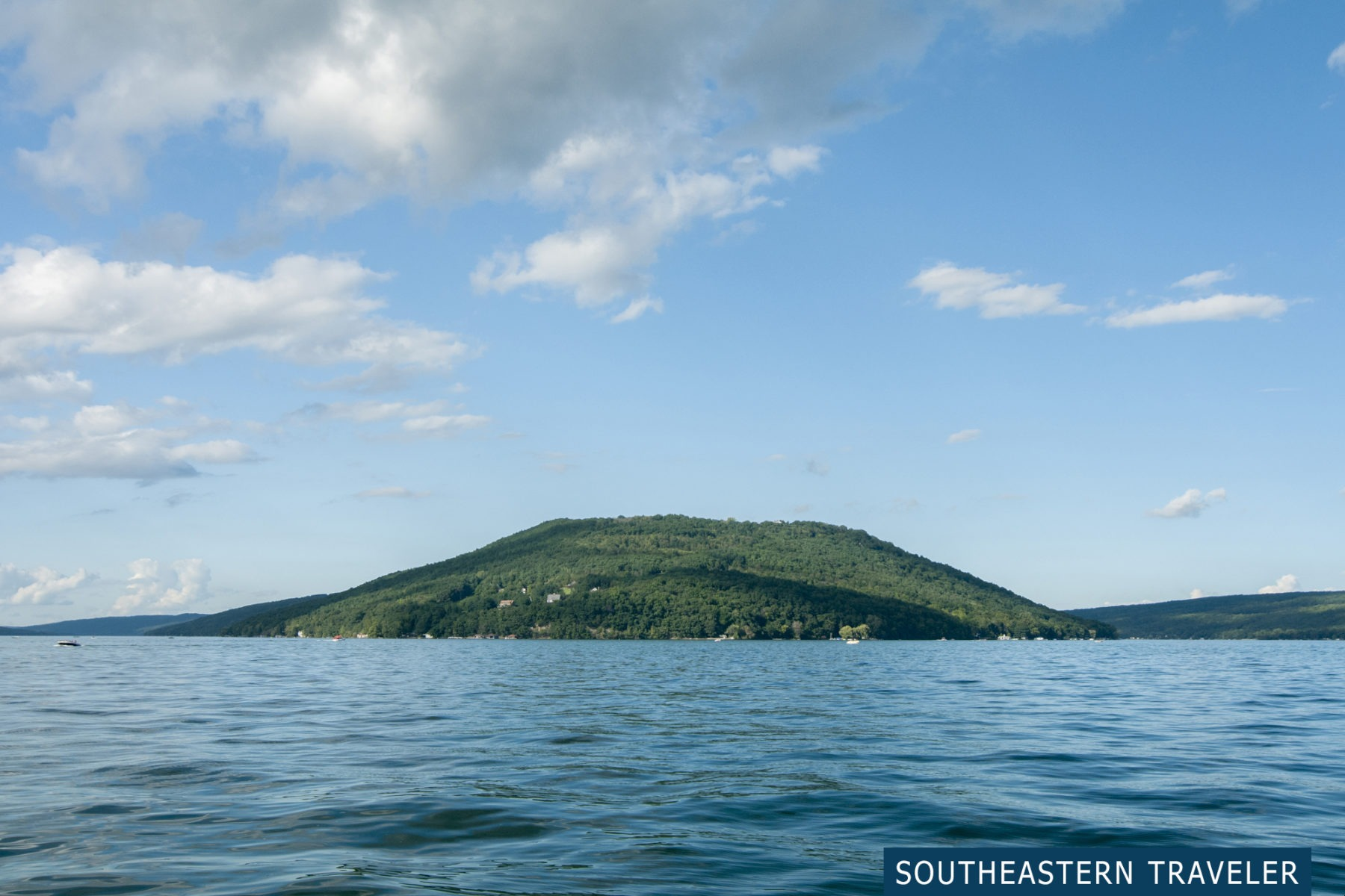 View of The Bluff from a boat on Keuka Lake in Hammondsport, New York