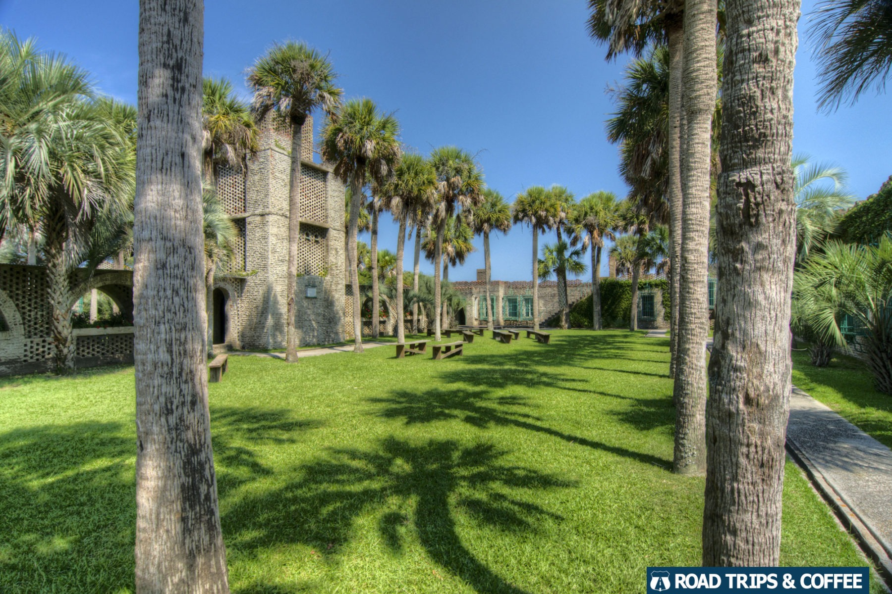Palm trees and benches in the courtyard of Atalaya Castle at Huntington Beach State Park in Murrells Inlet, South Carolina