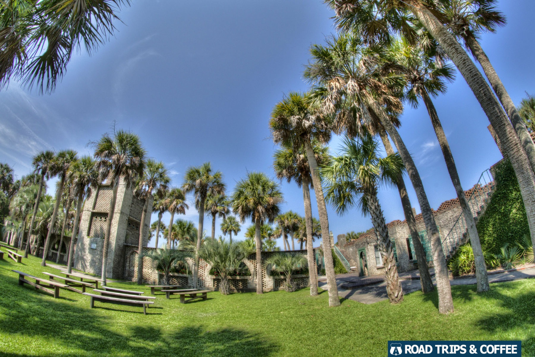 Inner courtyard with towering palm trees at Atalaya Castle in Huntington Beach State Park in Murrells Inlet, South Carolina
