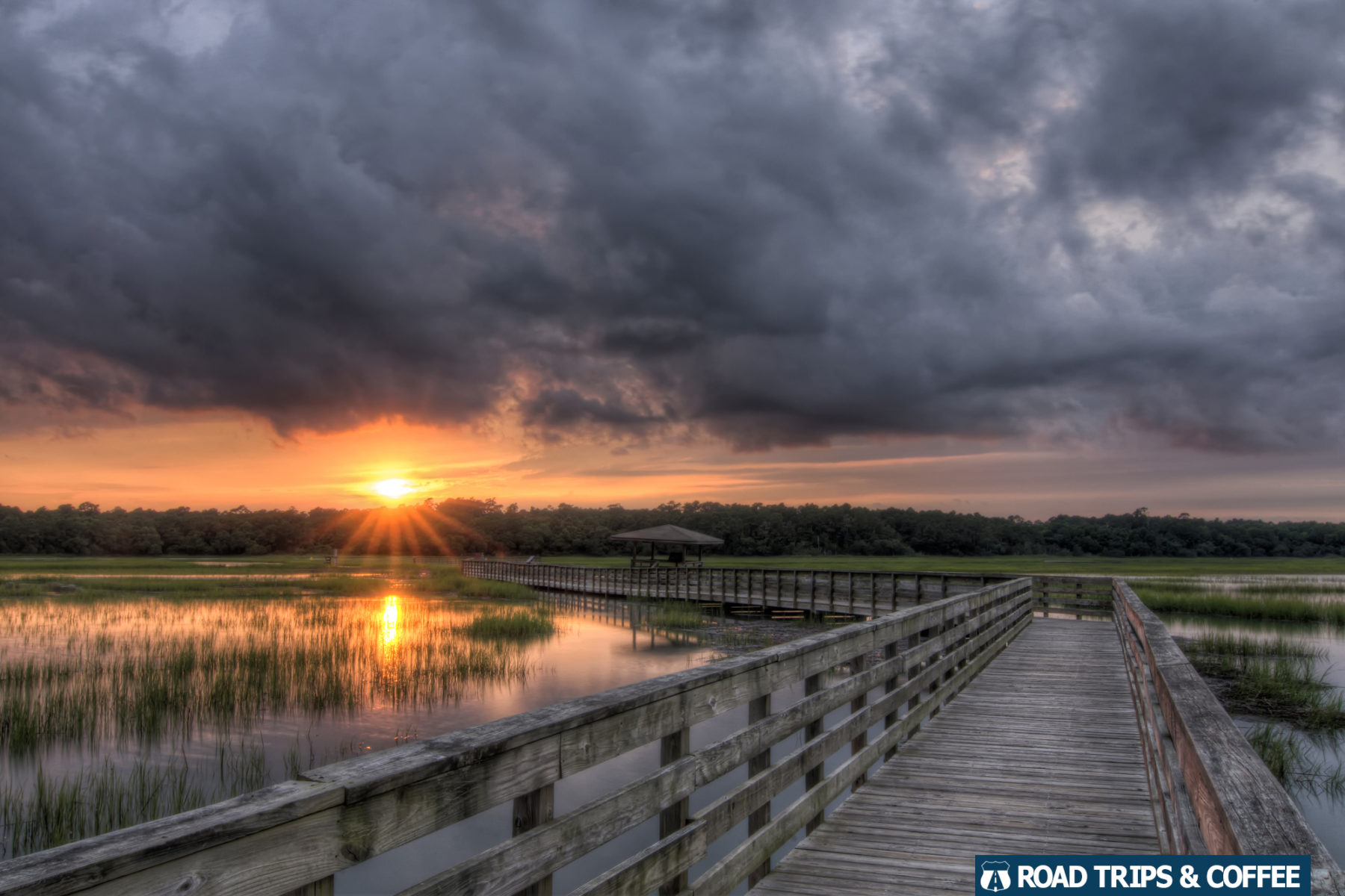 A stormy sunset across the saltwater marsh along the Boardwalk Trail at Huntington Beach State Park in Murrells Inlet, South Carolina