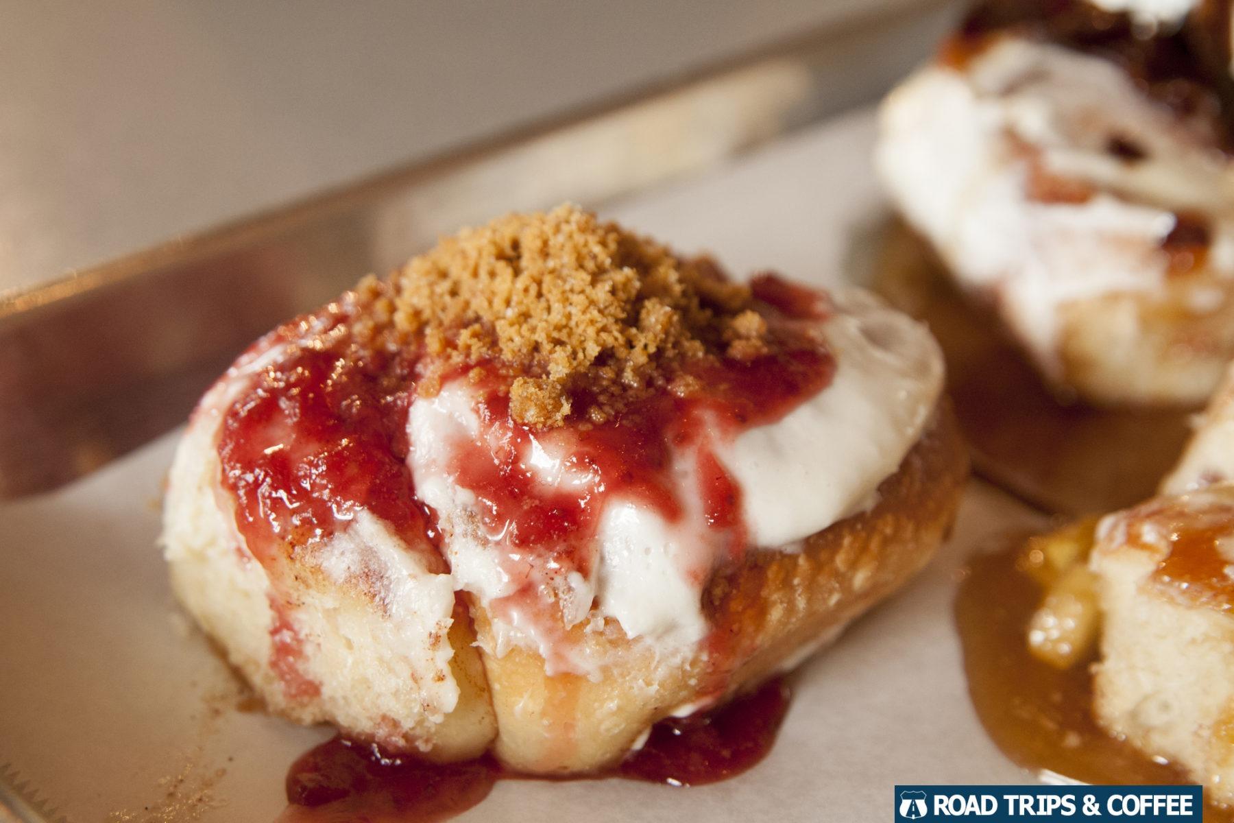 A strawberry cream cheese mini cinnamon roll at The Devine Cinnamon Roll Deli during brunch in Columbia, SC