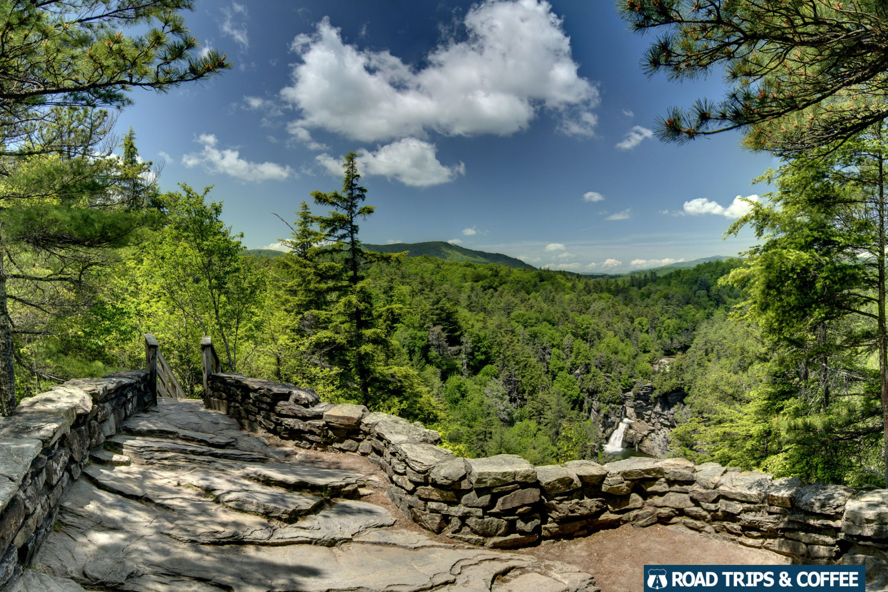 A wide scenic overlook with the waterfall in the distance at Erwin's View at Linville Falls on the Blue Ridge Parkway in North Carolina