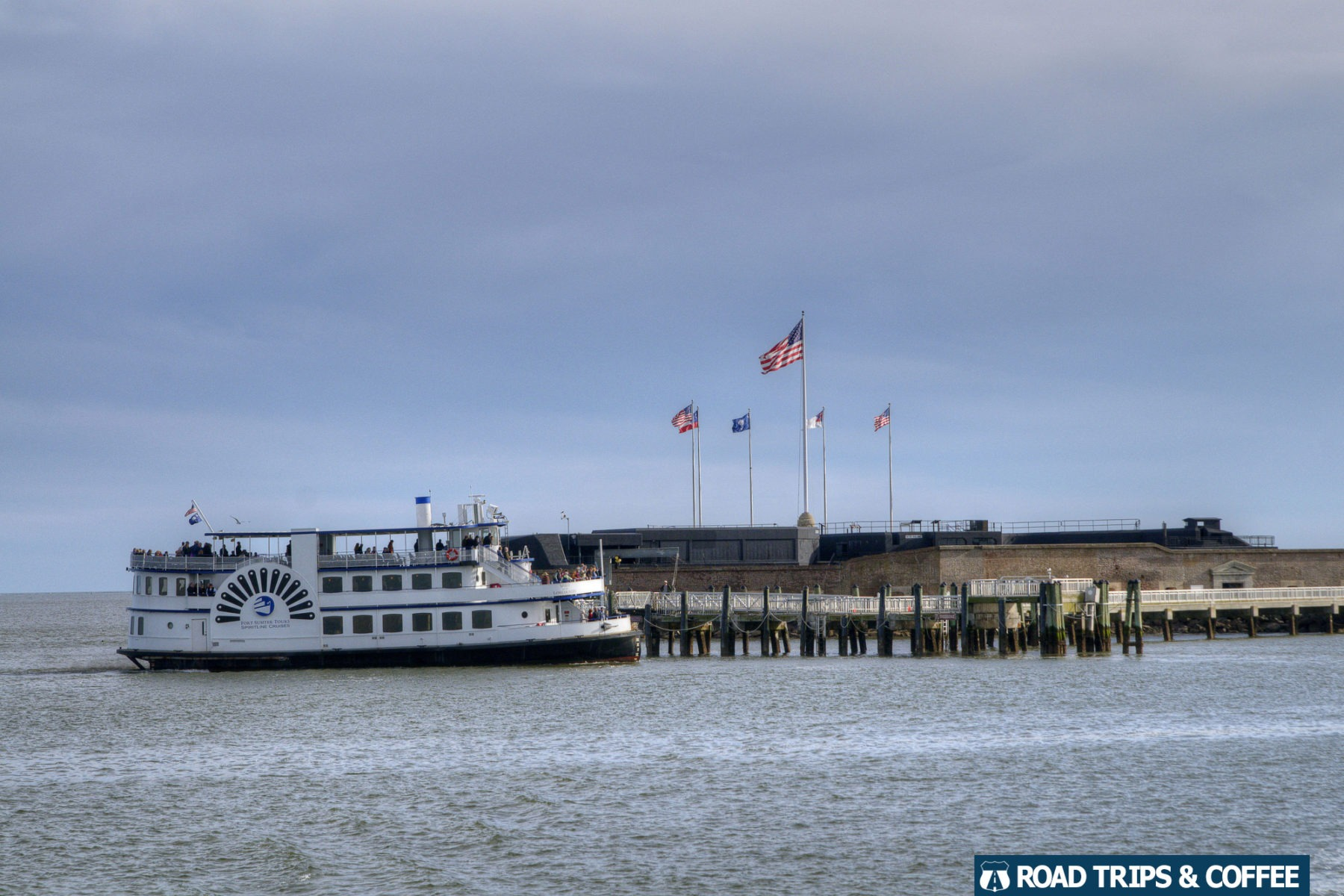 A tour boat pulls up to the dock at Fort Sumter and Fort Moultrie National Historic Site in Charleston, South Carolina