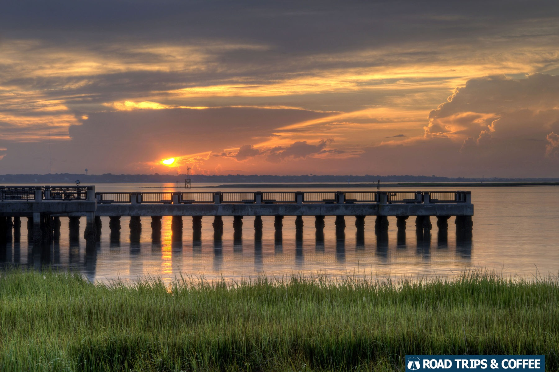Sunrise across the Cooper River at Waterfront Park in Charleston,  South Carolina