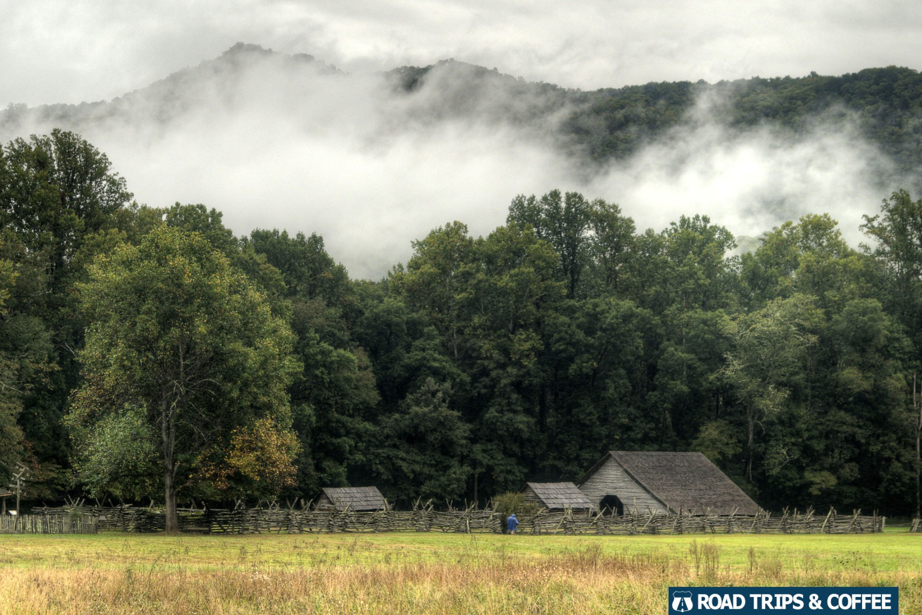 Heavy fog on the mountains above the rustic Mountain Farm Museum in the Great Smoky Mountains National Park
