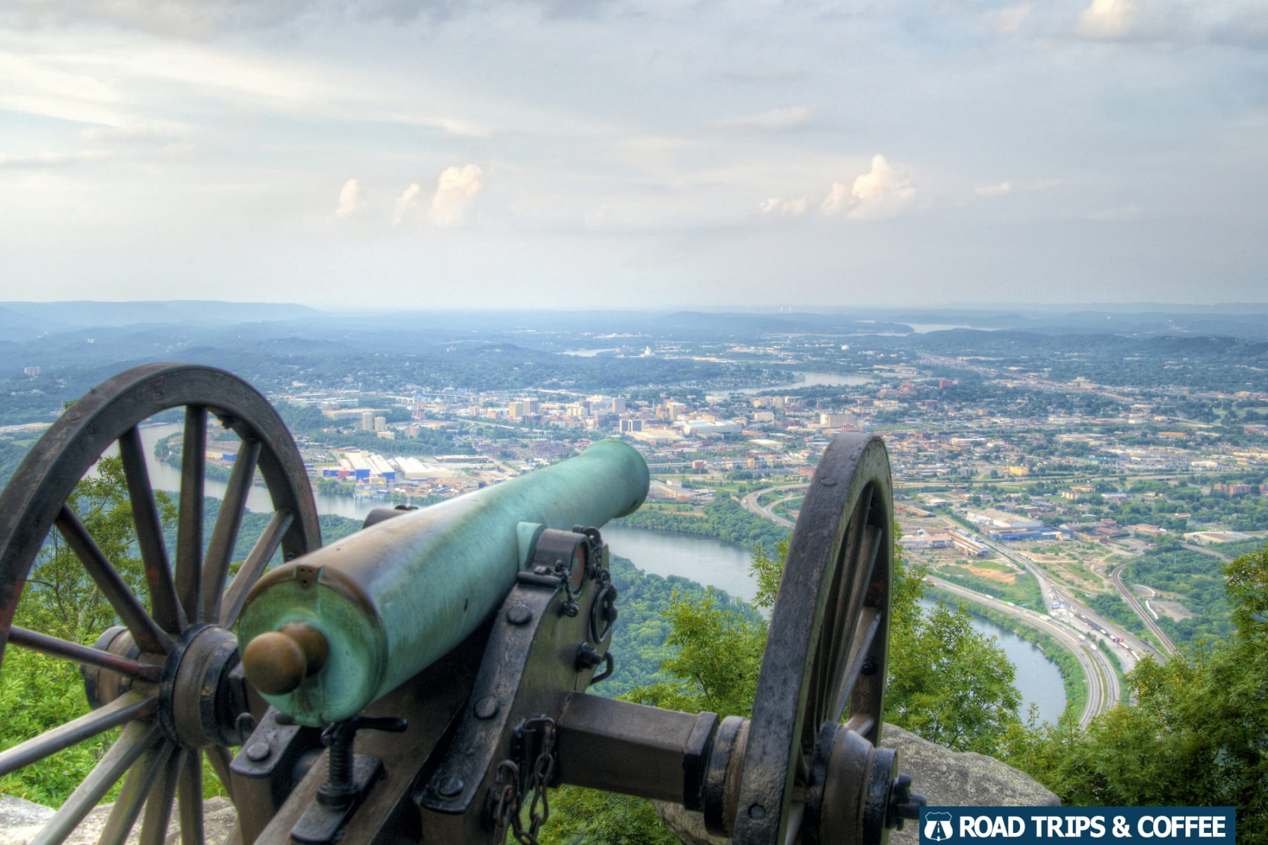 A canon on display at Point Park with a view of downtown Chattanooga, Tennessee in the distance