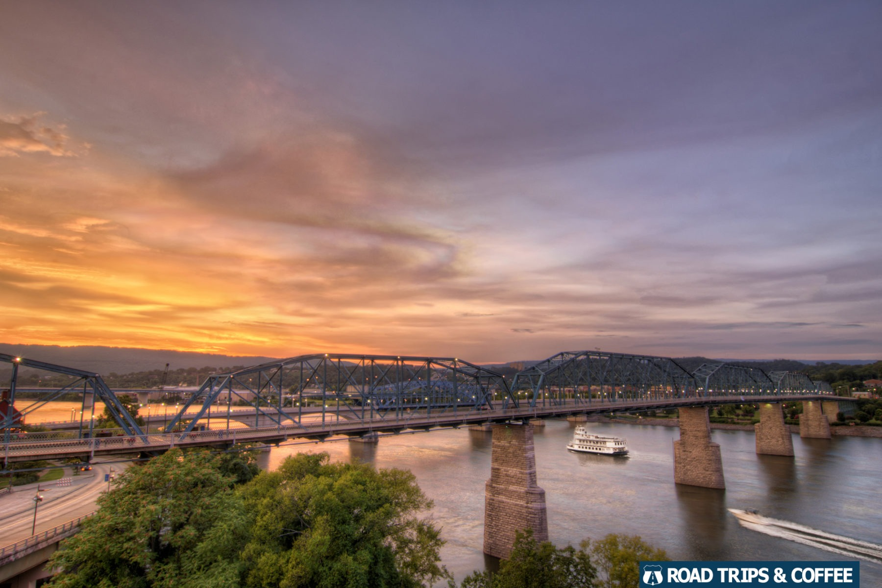 Vibrant orange sunset across the Walnut Street Bridge and Tennessee River in Chattanooga, Tennessee