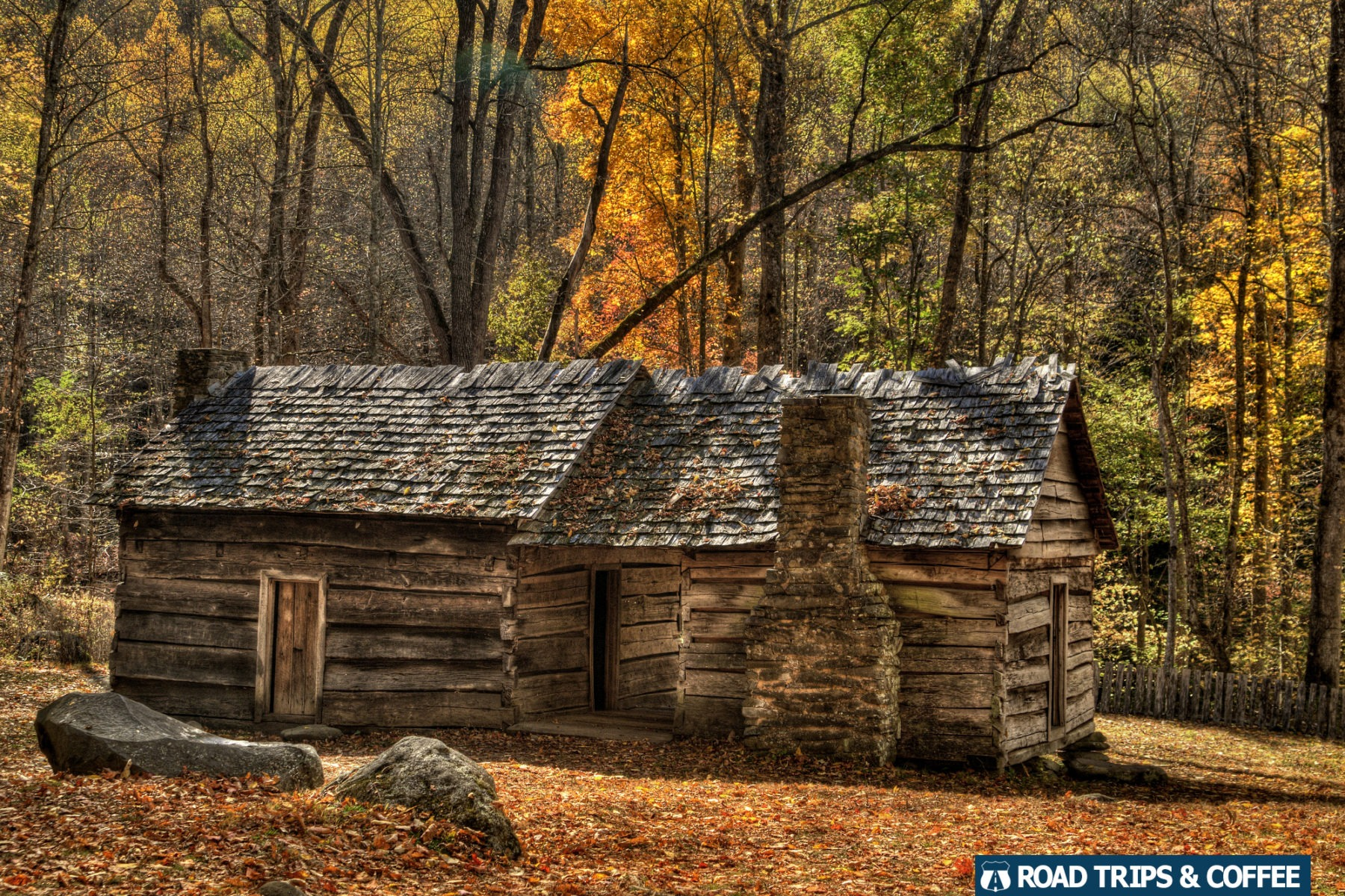 Vibrant fall colors surround a rustic cabin in the Great Smoky Mountains National Park