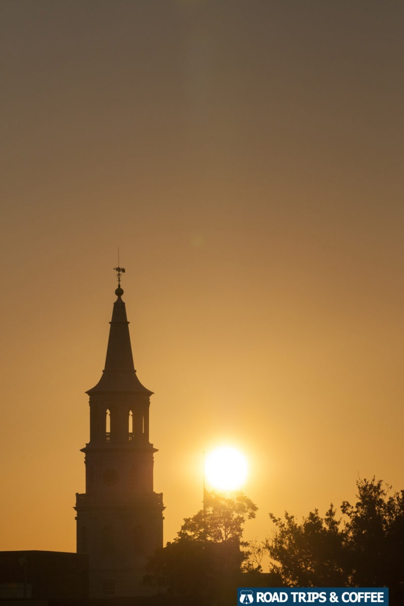 A warm sunset behind the silhouettes of church steeples in Charleston, South Carolina