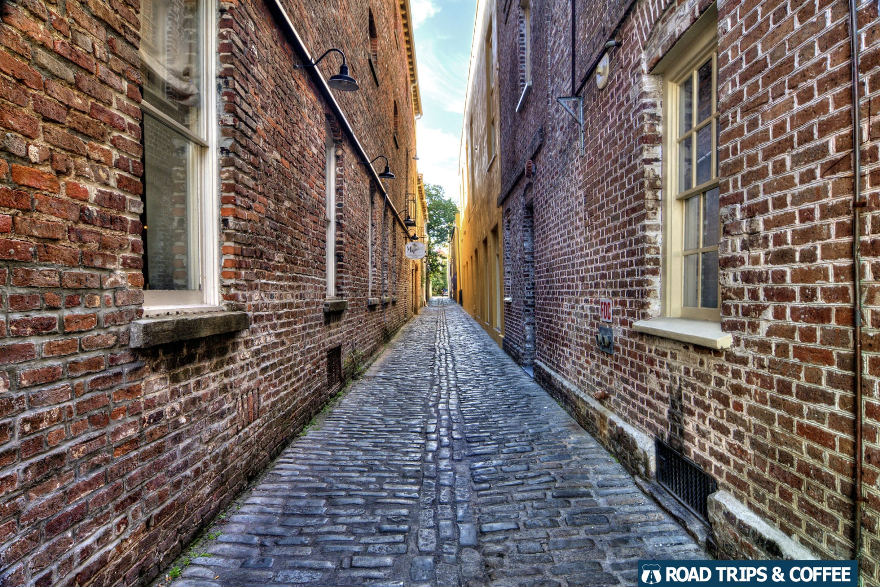 A long cobblestone alley in downtown Charleston, South Carolina
