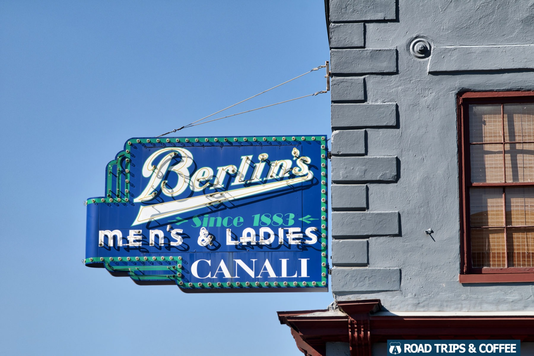 The historic sign of Berlin's hanging on the side of a building in Charleston, South Carolina