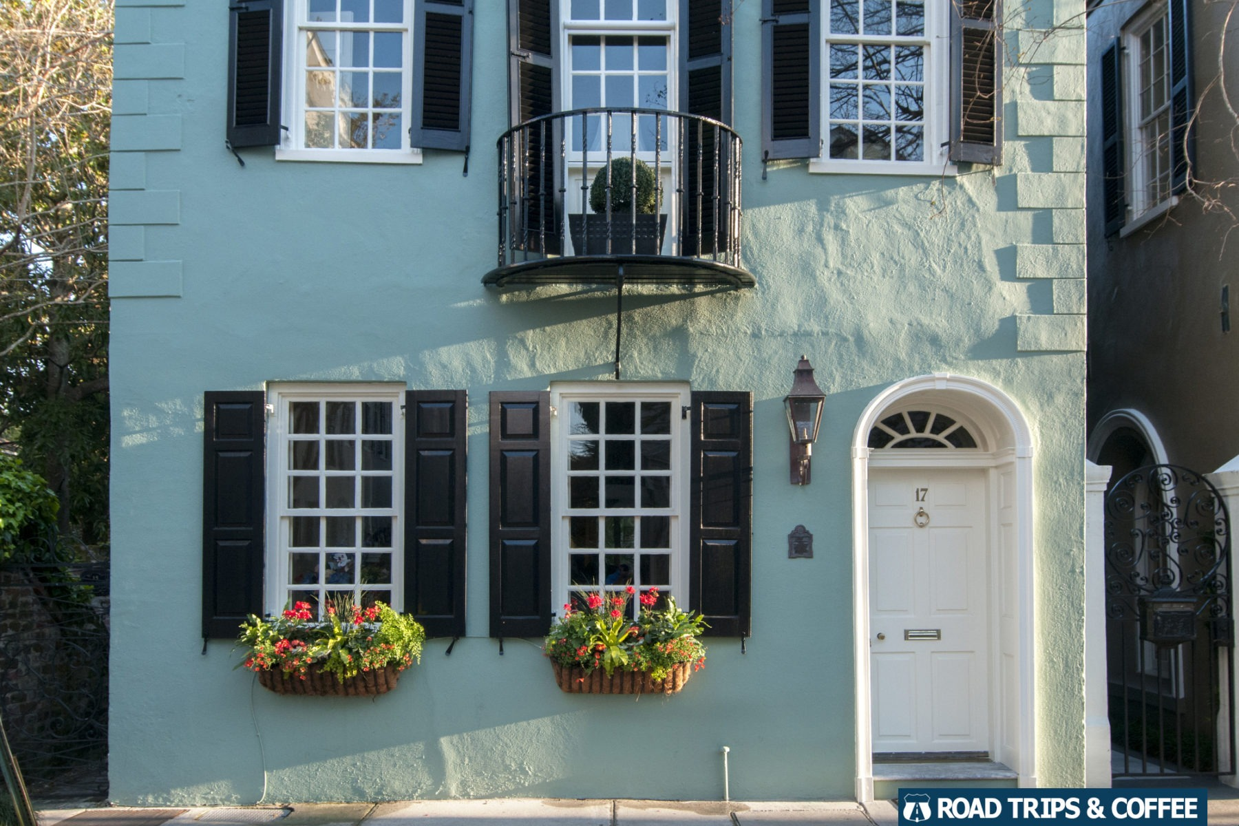 A typical single house with wrought iron balcony and flower boxes in Charleston, South Carolina