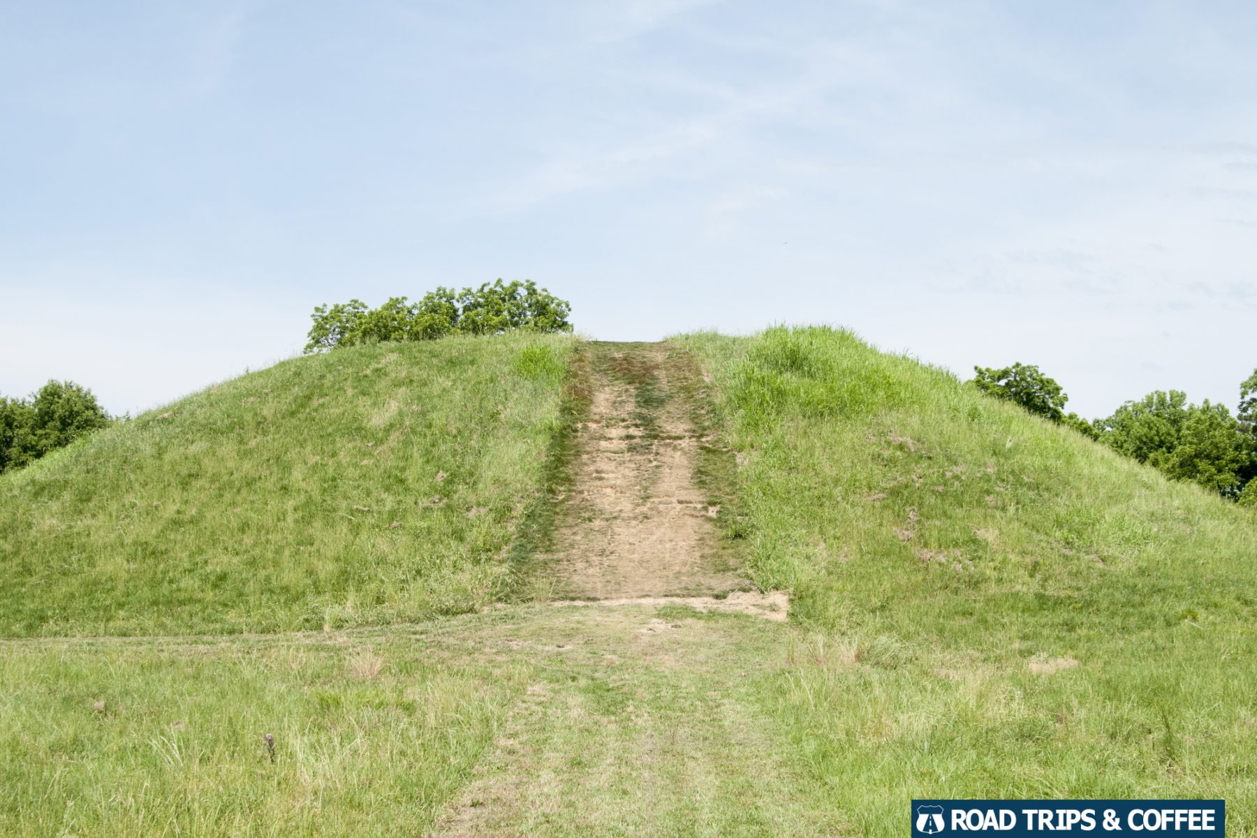A sharp slope of the grass-covered Emerald Mound at Milepost 10.3 on the Natchez Trace Parkway in MIssissippi