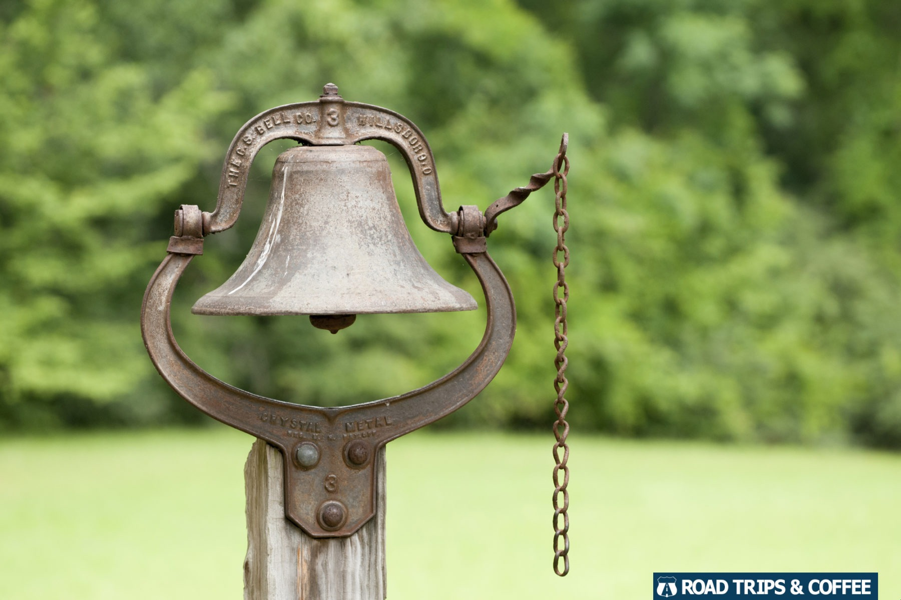 An old bell with a bull chain on a post at Mount Locus at Milepost 15.5 on the Natchez Trace Parkway in Mississippi