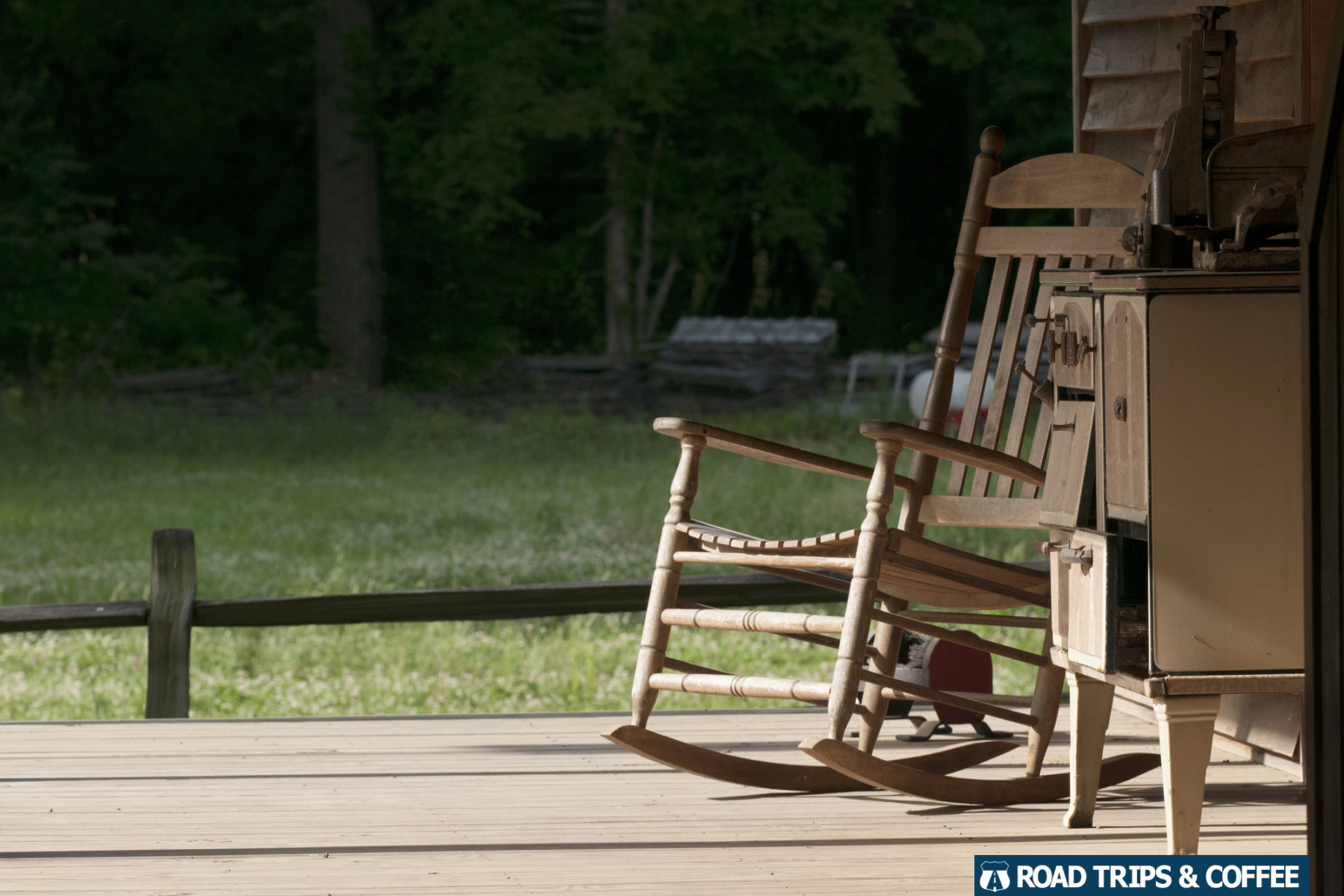 An old rocking chair on the porch of a log house at French Camp on the Natchez Trace Parkway in Mississippi
