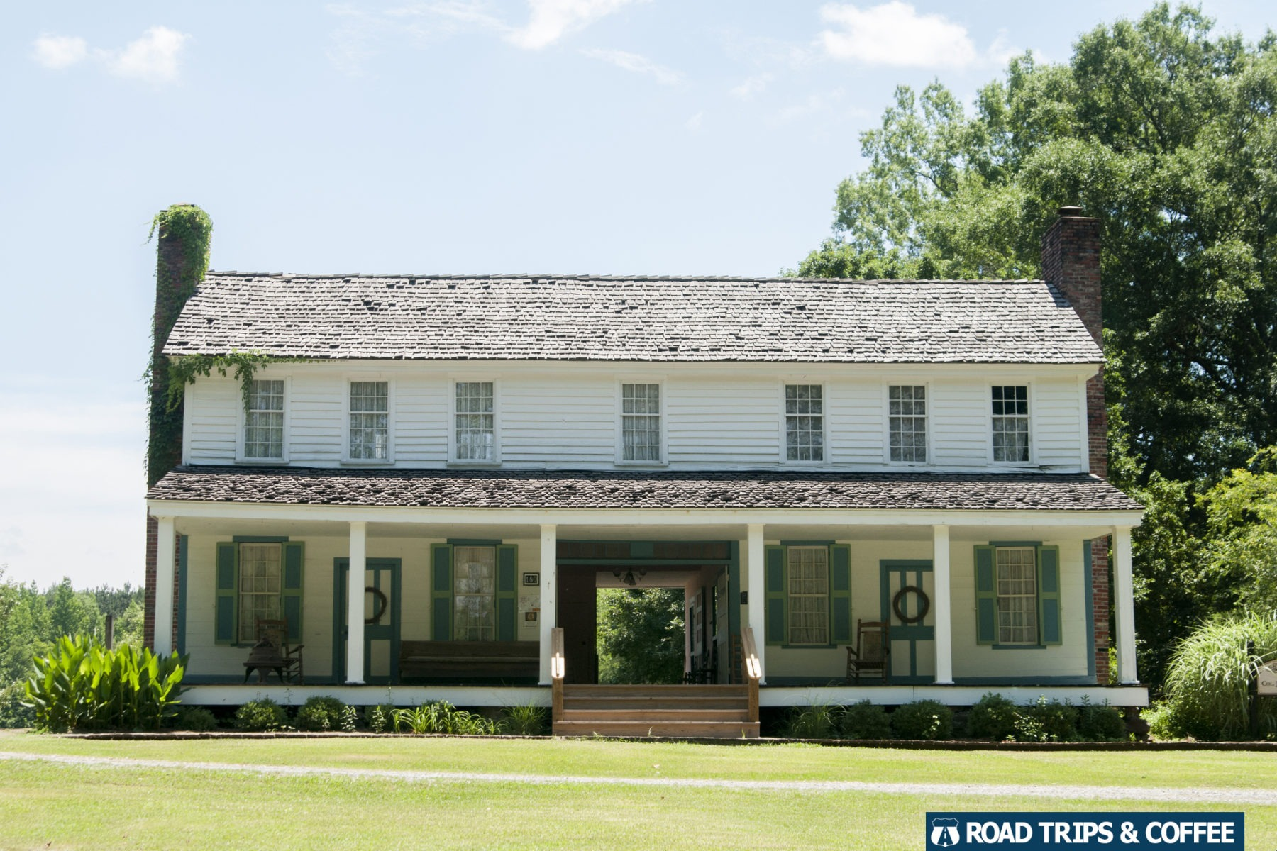 A large white dog trot house at  French Camp on the Natchez Trace Parkway in Mississippi