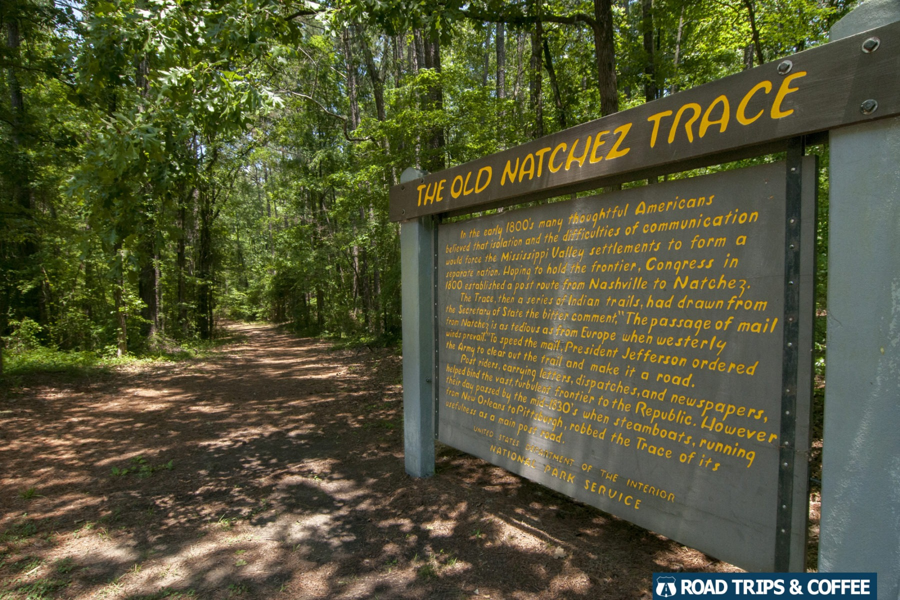 A large wooden sign explaining The Old Natchez Trace on the Natchez Trace Parkway in Mississippi