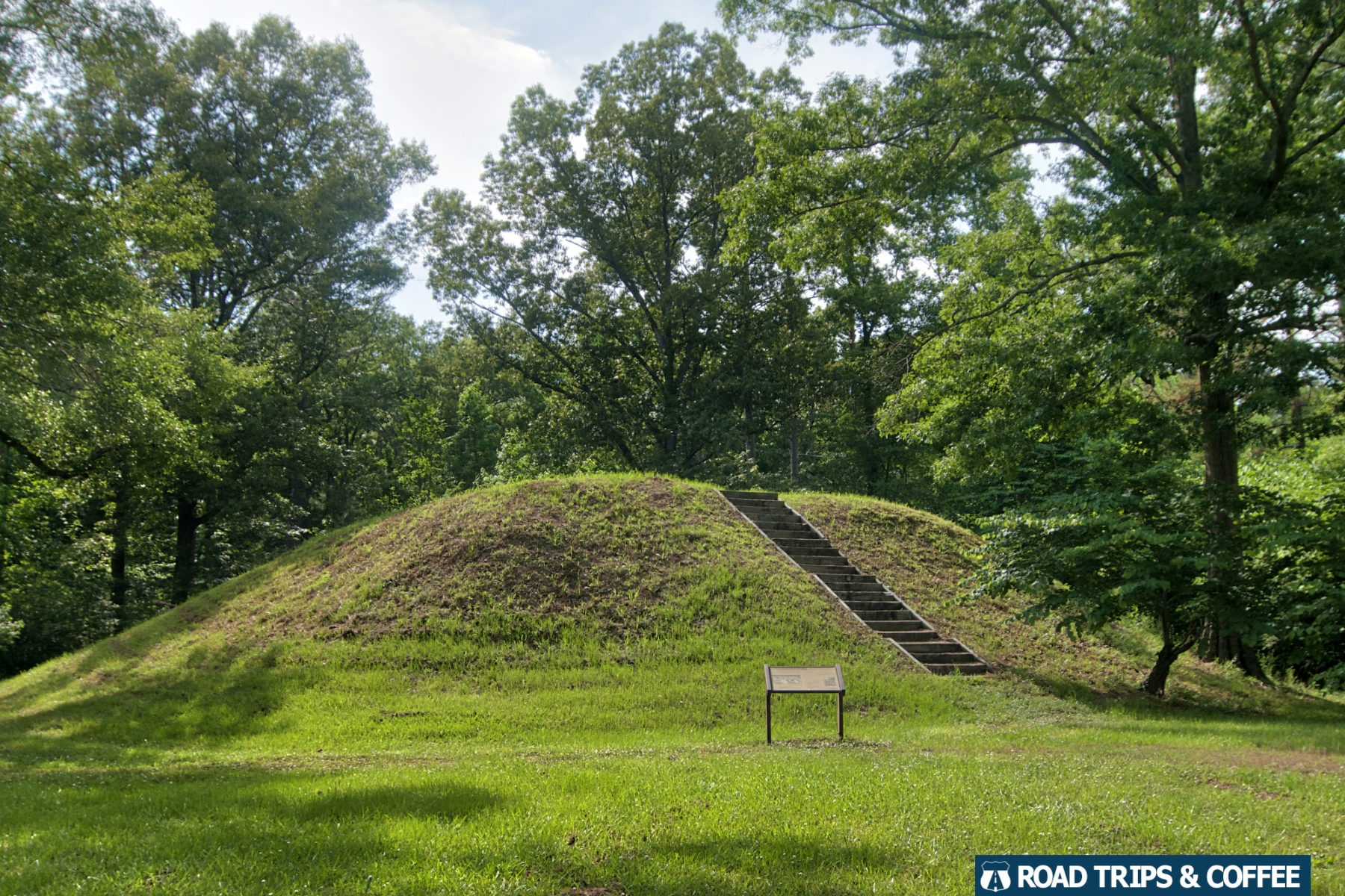 The gentle rise of the grass-covered Owl Creek Mounds on the Natchez Trace Parkway in Mississippi