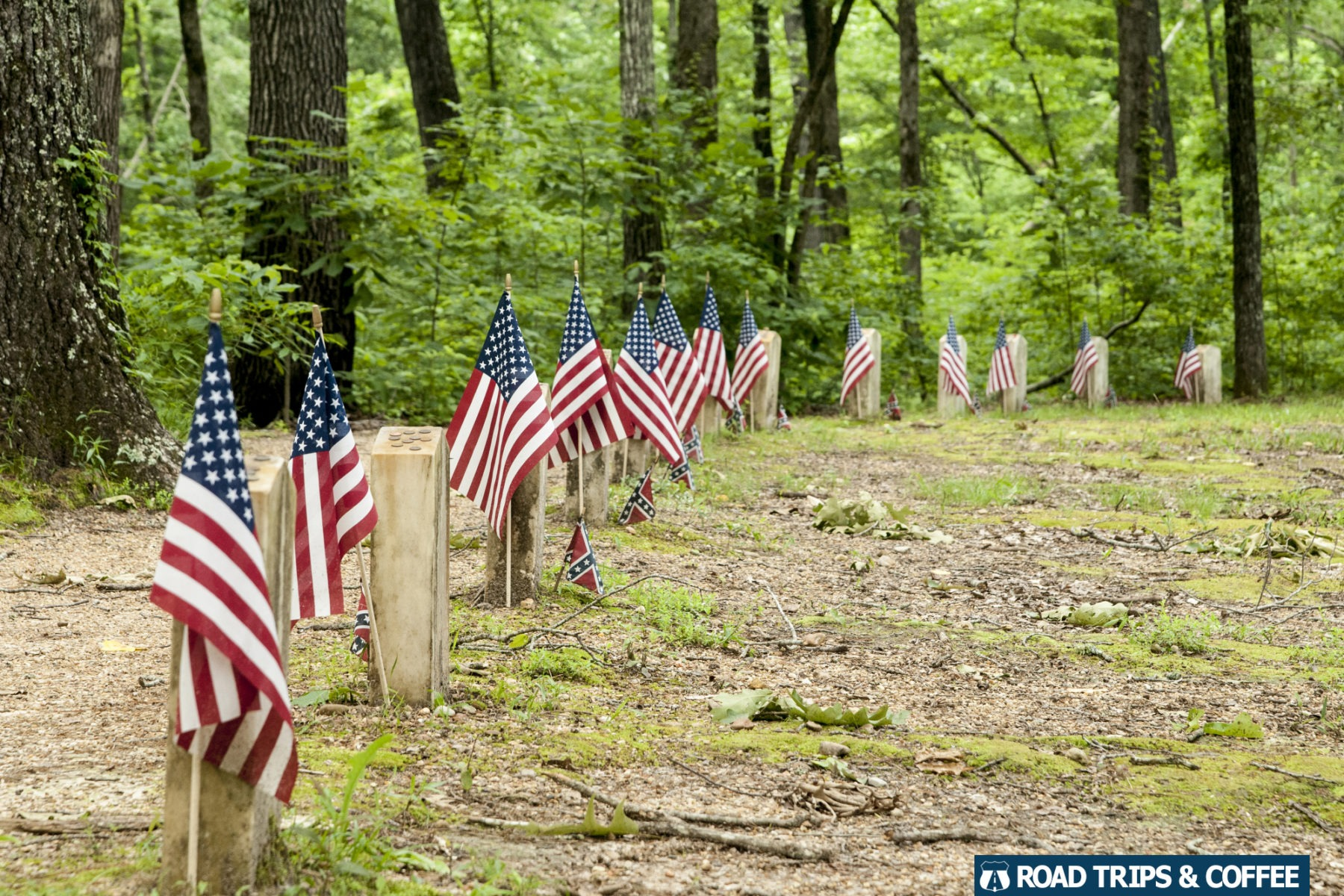 American flags adorn the small white Confederate Gravesites on the Natchez Trace Parkway in Mississippi