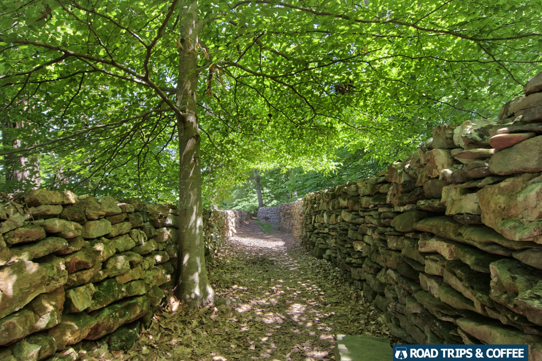 Thousands of stones built into a man-made wall at Tom's Wall, officially known as the Wachapi Commemorative Stone Wall, on the Natchez Trace Parkway in Alabama