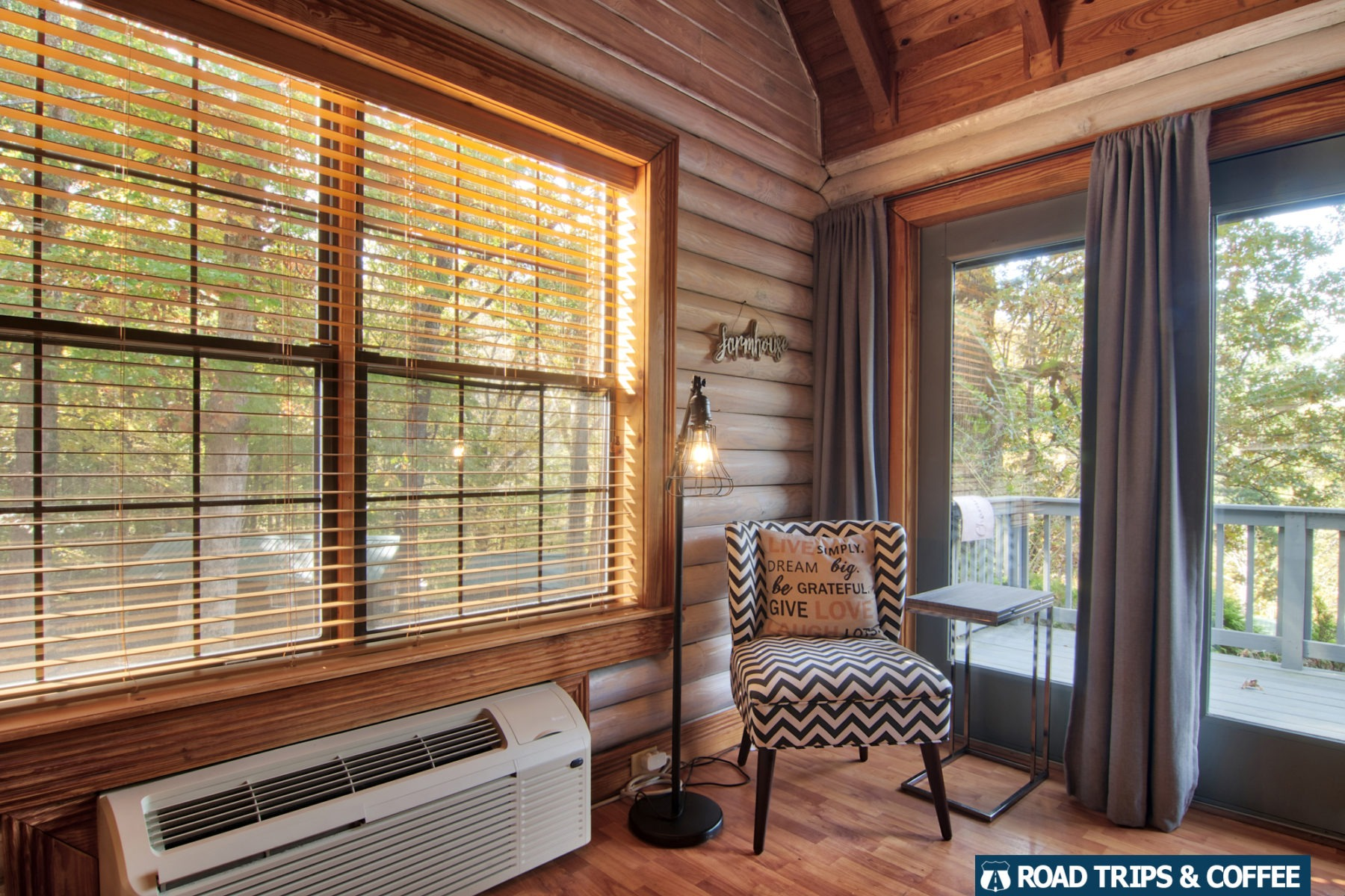 A large window and all-glass front door let in plenty of sunlight at the premiere cabin at Little Arrow Outdoor Resort in Townsend, Tennessee