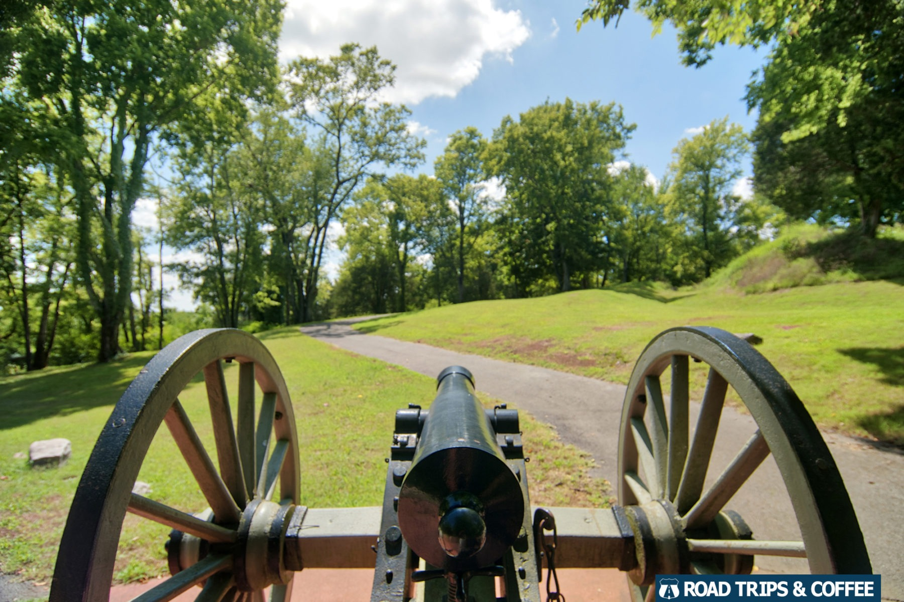 A Civil War-era canon beside a hiking trail at Fort Defiance Civil War Park in Clarksville, Tennessee