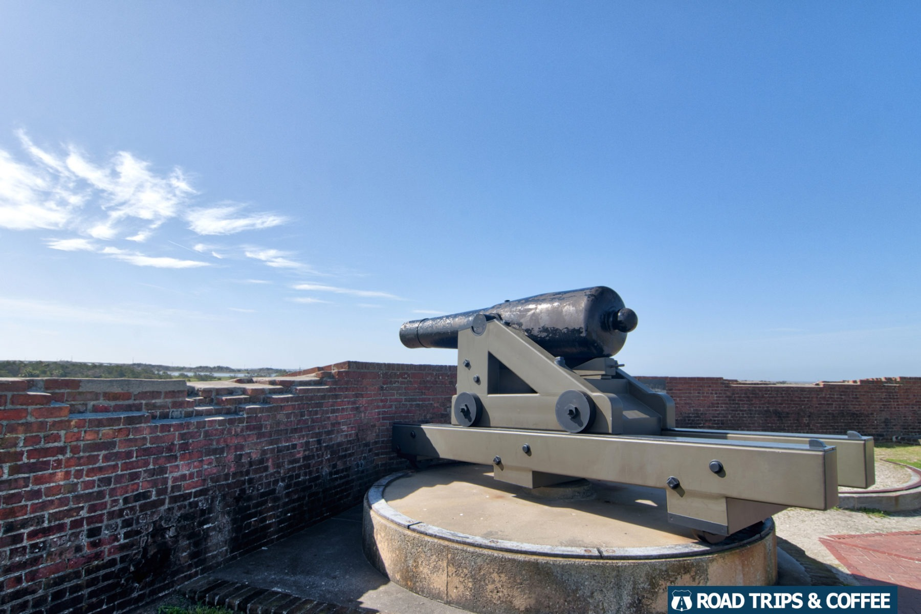 A large canon on display on the top level of Fort Pulaski National Monument in Savannah, Georgia