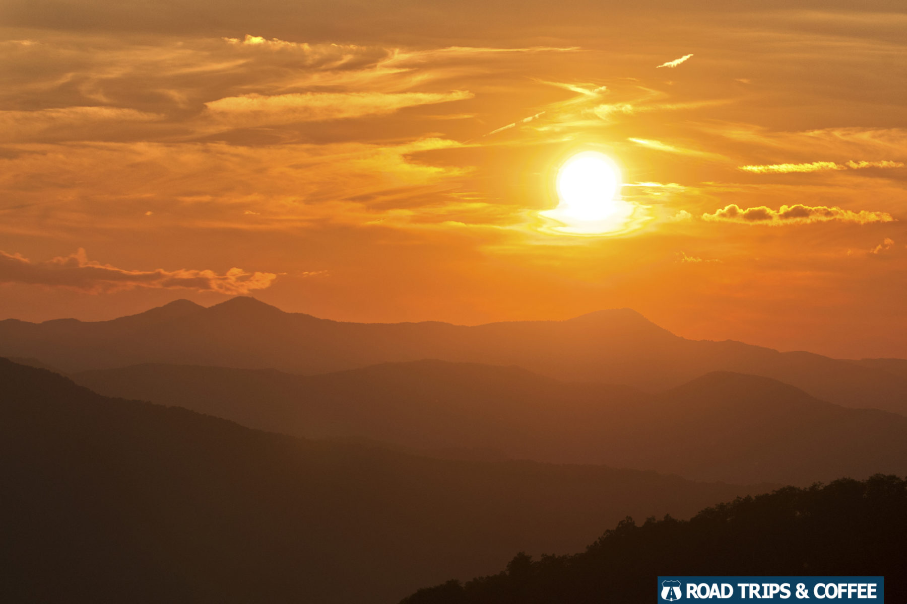 Warm sunset view across the mountain landscape from the Mount Pisgah Overlook on the Blue Ridge Parkway in North Carolina