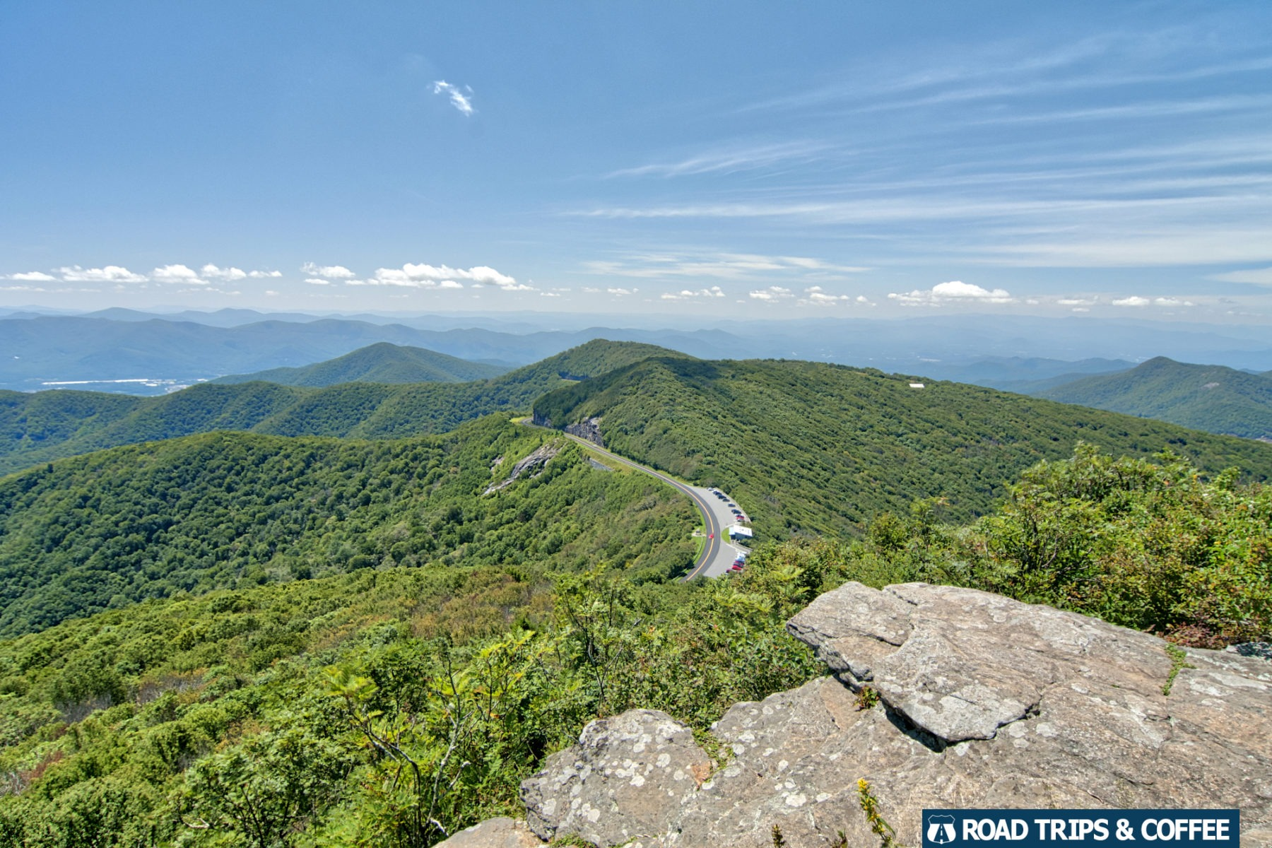 View of local mountains and the trailing road in the distance at Craggy Pinnacle on the Blue Ridge Parkway in North Carolina