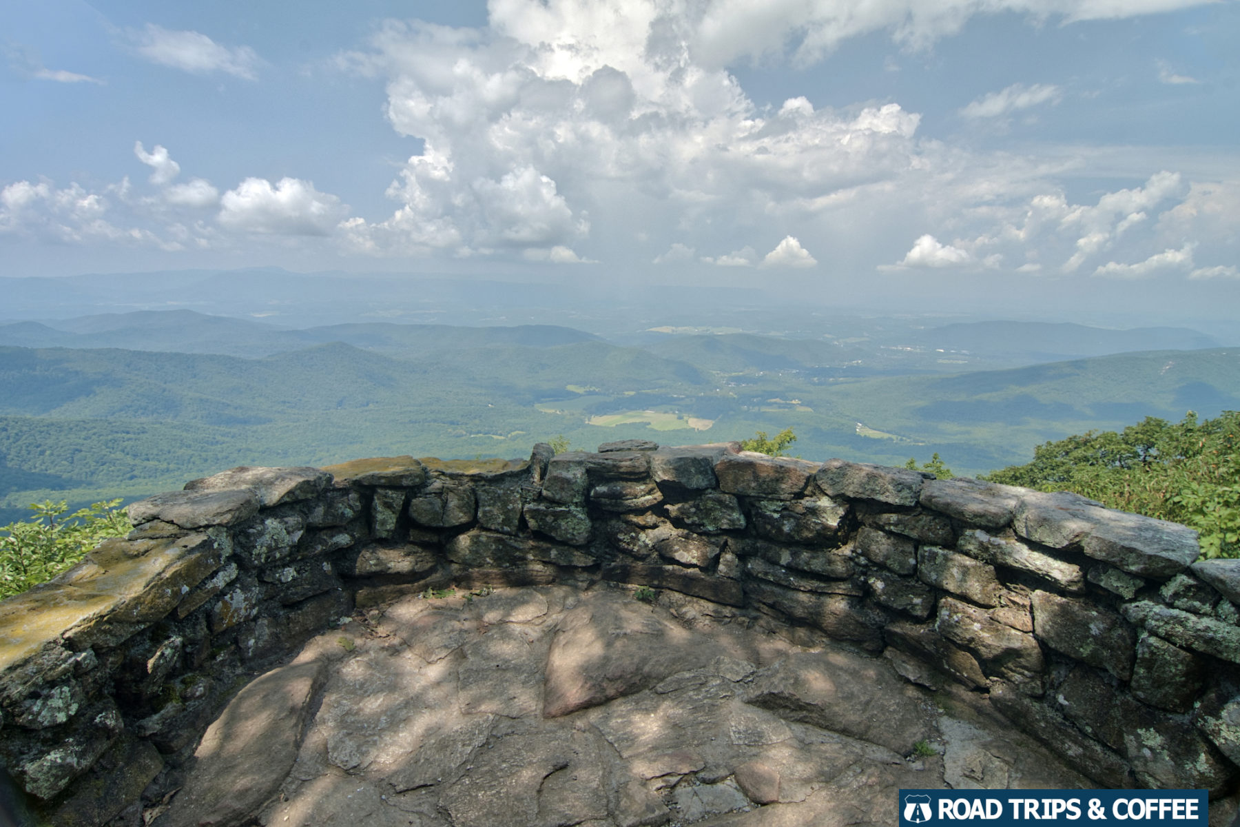 A stone wall surrounds the Thunder Ridge Overlook on the Blue Ridge Parkway in Virginia