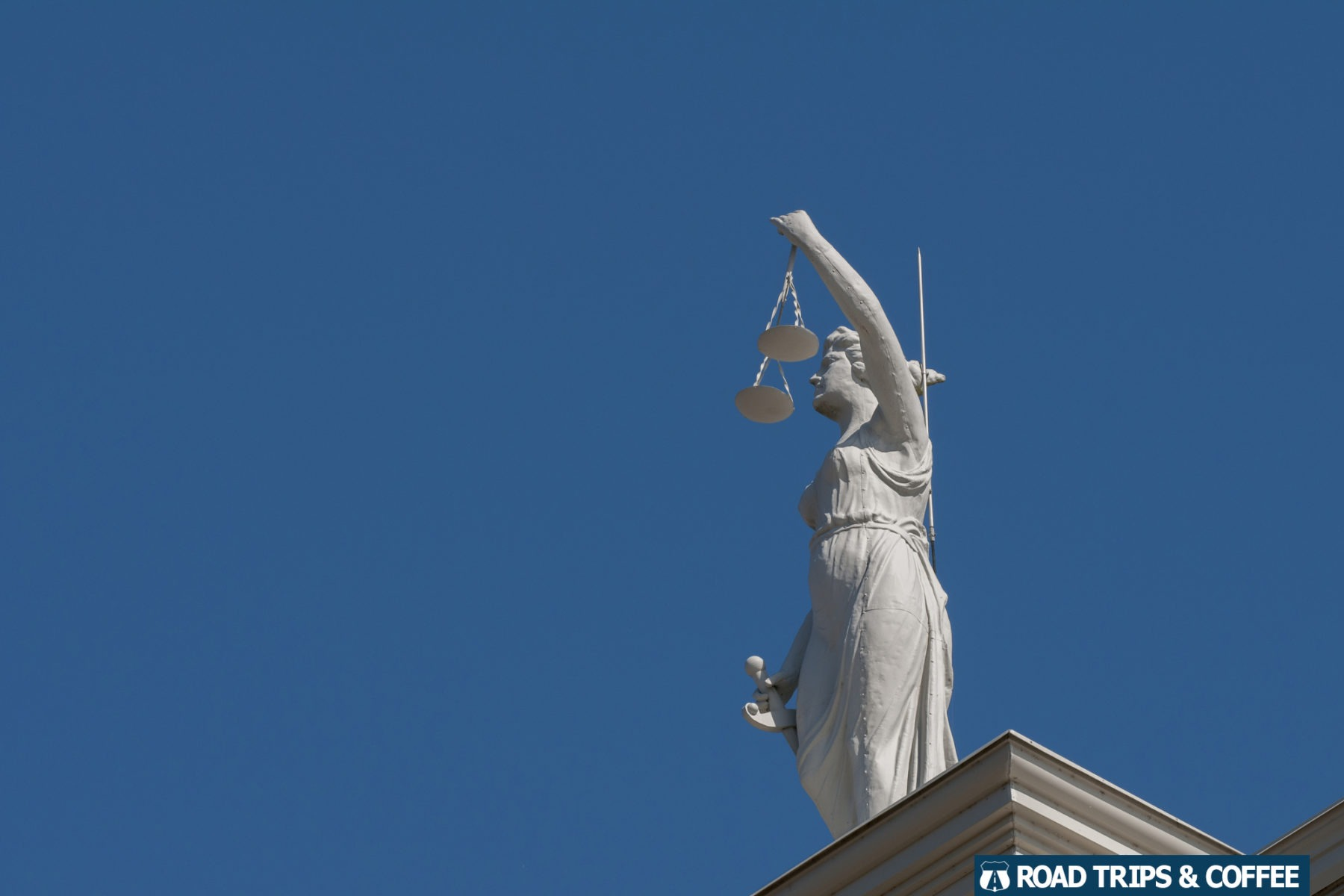 Statue of Lady Justice holding scales on the Montgomery County Historic Courthouse in Clarksville, Tennessee