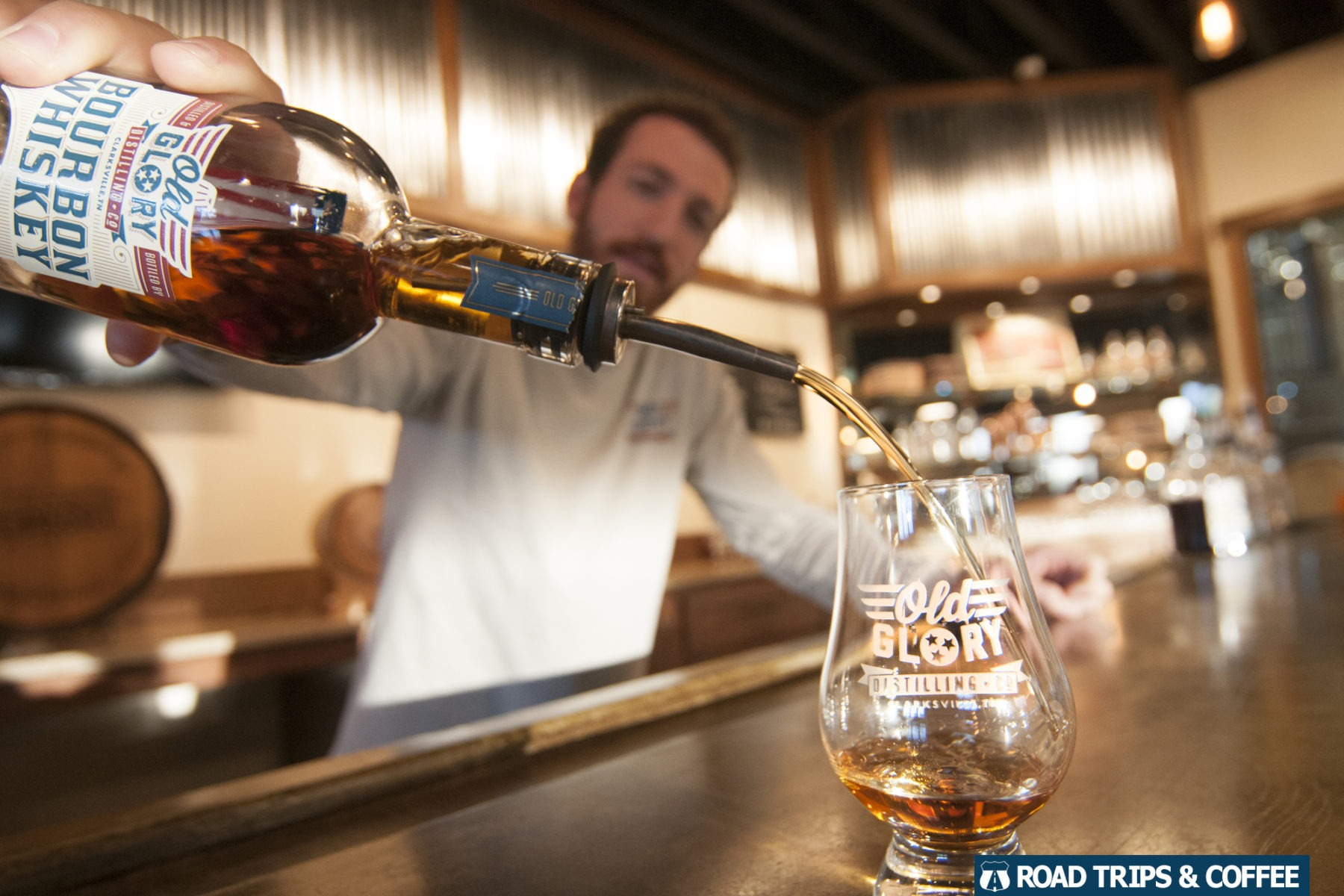 The owner of the Old Glory Distilling Company pours a sample of his vodka in Clarksville, Tennessee