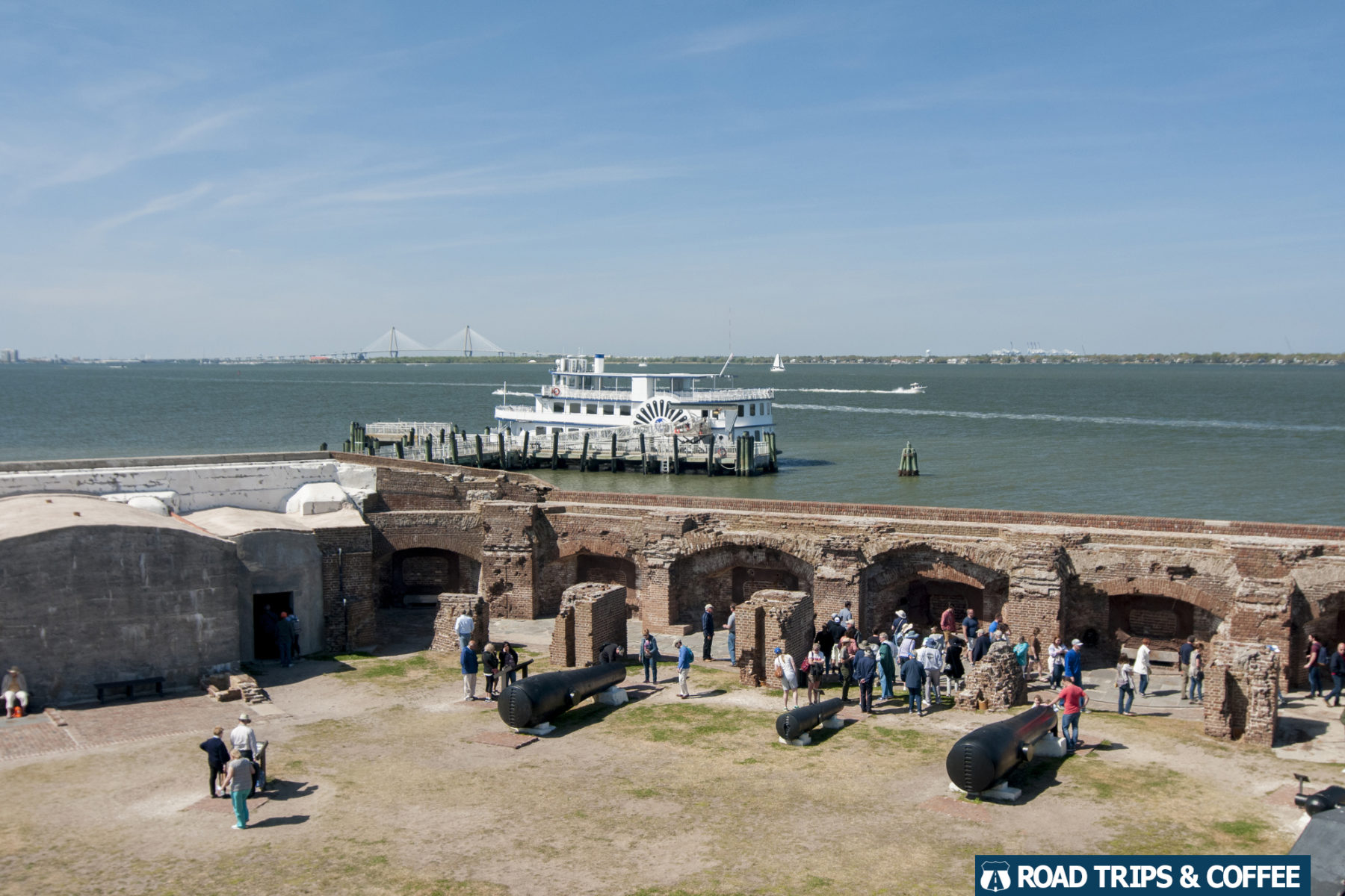 A view across Fort Sumter, a tour boat, and Charleston Harbor at the Fort Sumter & Fort Moultrie National Historical Park in Charleston, South Carolina