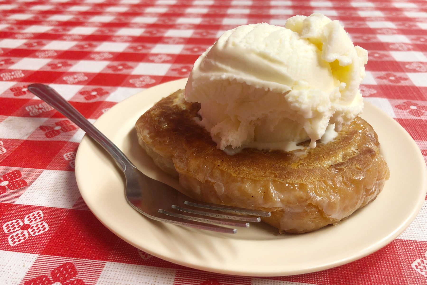 A fried honey bun with a scoop of vanilla ice cream on top at Johnny's Big Burger in Clarksville, Tennessee